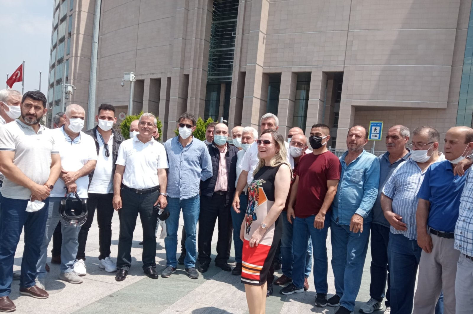 Firefighters and their lawyer outside the courthouse in Istanbul, Turkey, June 24, 2021. (DHA PHOTO)