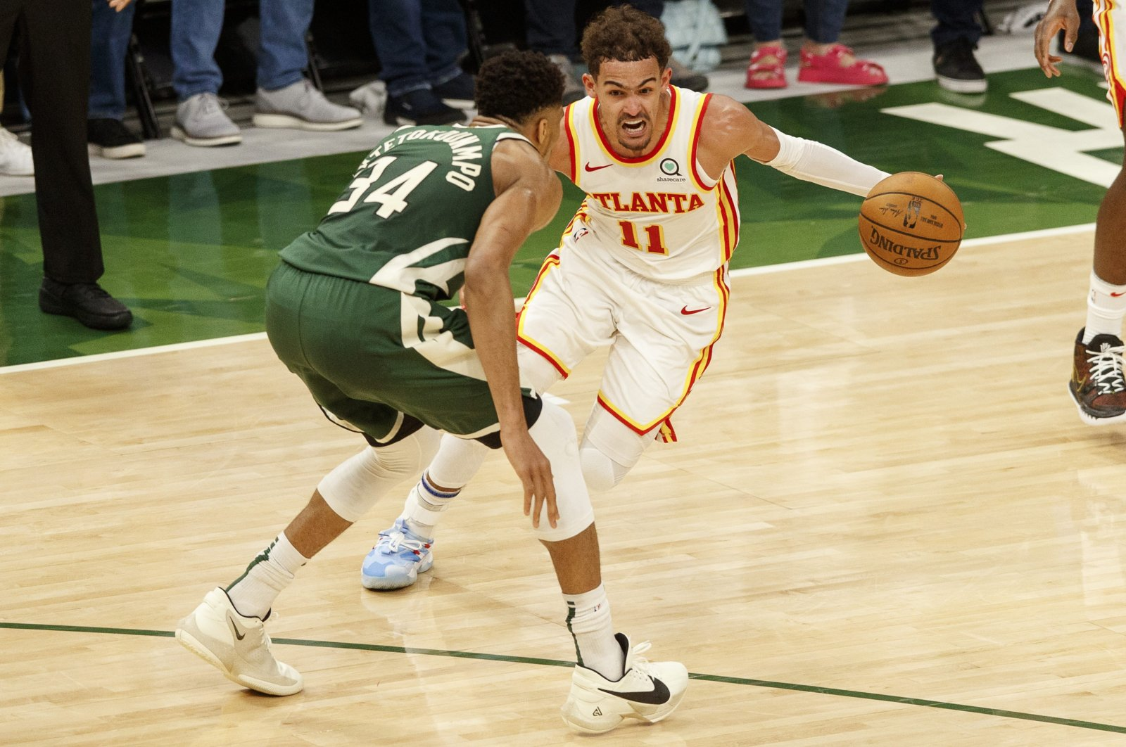 Atlanta Hawks guard Trae Young (R) drives for the basket against Milwaukee Bucks forward Giannis Antetokounmpo during Game 1 of the Eastern Conference Finals for the 2021 NBA Playoffs at Fiserv Forum, Milwaukee, Wisconsin, U.S., June 23, 2021. (Reuters Photo)