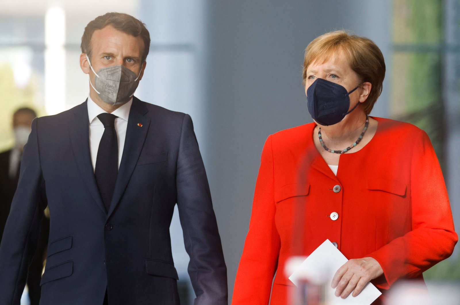 German Chancellor Angela Merkel and French President Emmanuel Macron arrive to address a press statement ahead of talks at the Chancellery in Berlin, Germany, June 18, 2021. (AFP Photo)
