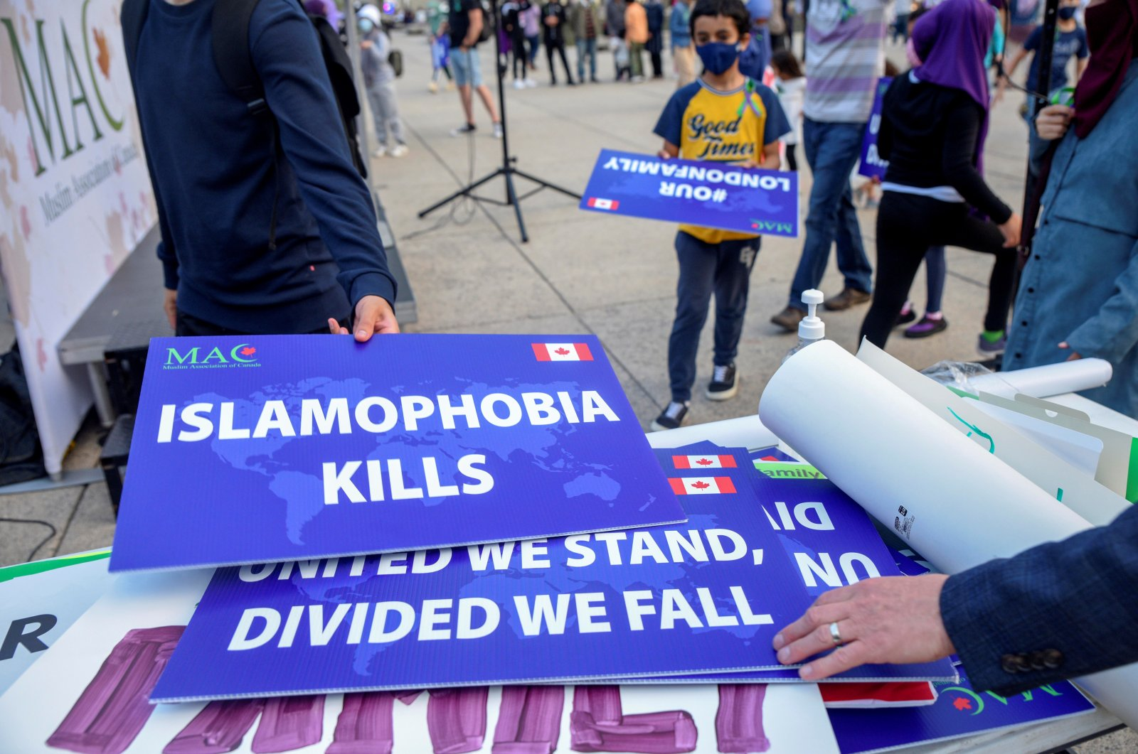 Attendees return signs after a rally to highlight Islamophobia, sponsored by the Muslim Association of Canada including the June 6 London, Ontario attack which killed a Muslim family in what police describe as a hate-motivated crime, in Toronto, Ontario, Canada, June 18, 2021. (Reuters Photo)