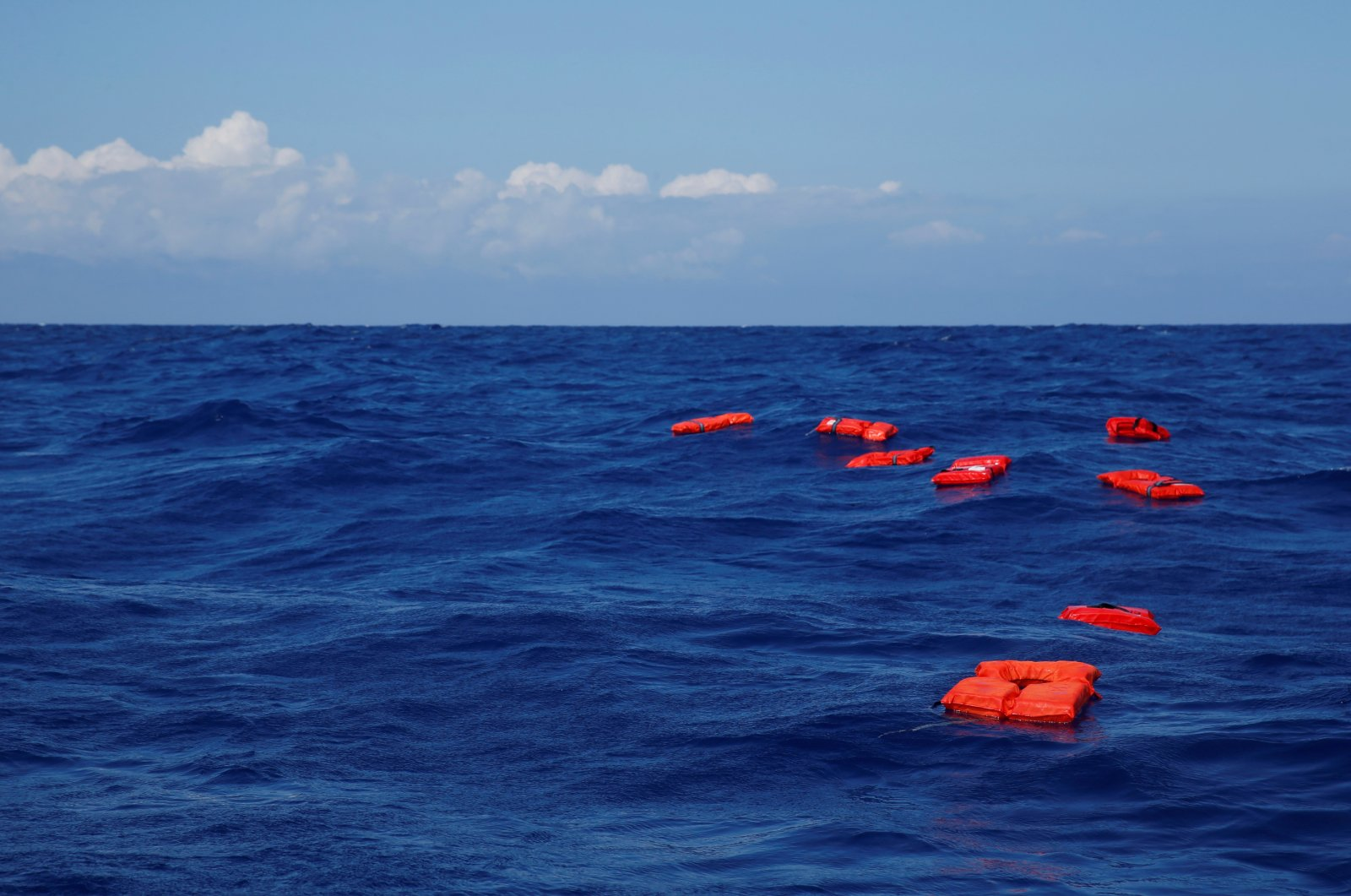 Life jackets float on the water during a training exercise by the German NGO Sea-Eye migrant rescue ship 'Alan Kurdi' while on its way to the search and rescue zone off the North African coast, in the western Mediterranean Sea, August 29, 2019. (Reuters File Photo)