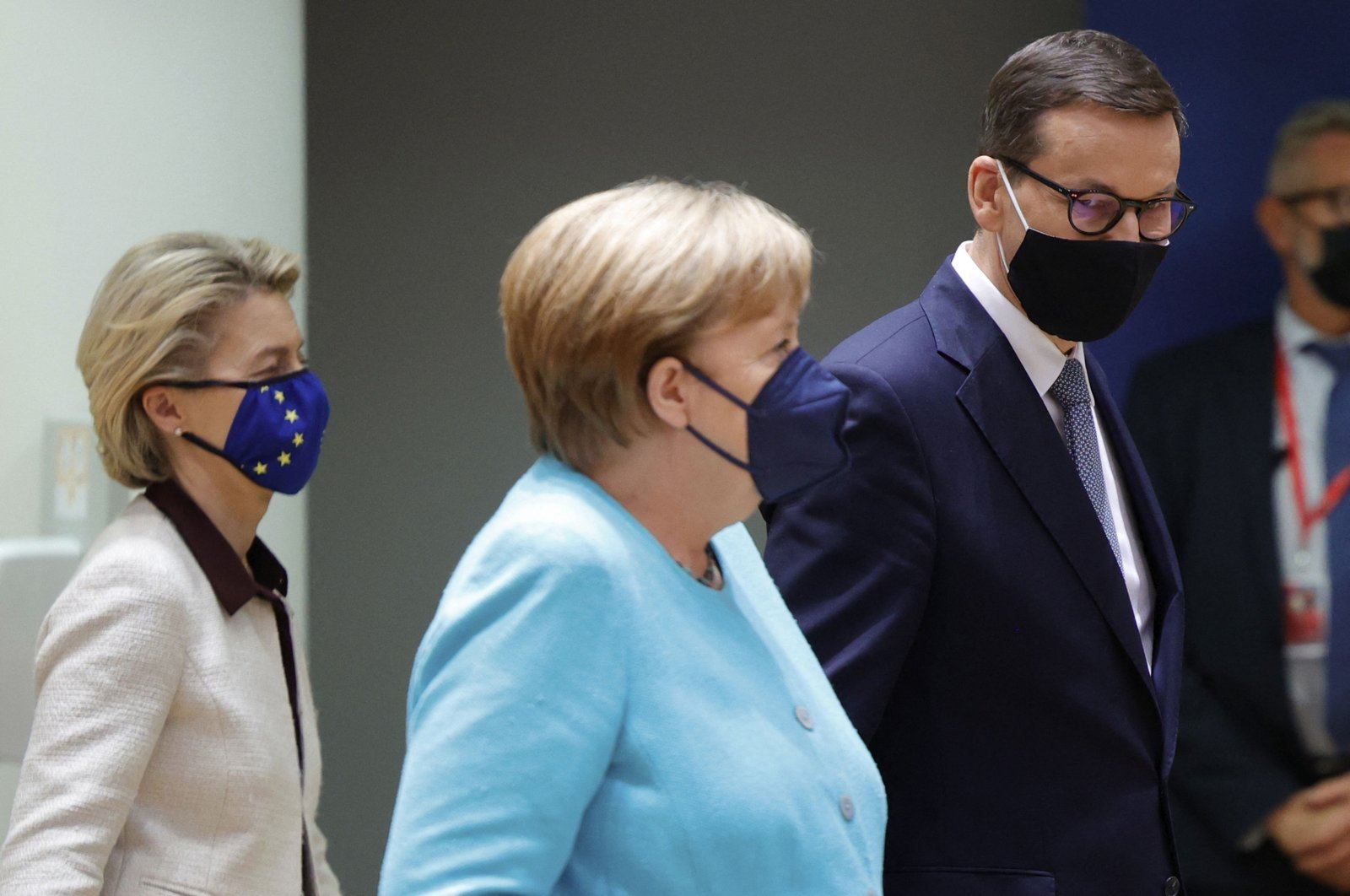 European Commission President Ursula von der Leyen (L) follows behind German Chancellor Angela Merkel (C) and Polish Prime Minister Mateusz Morawiecki on the first day of a European Union (EU) summit at the European Council Building in Brussels, Belgium, June 24, 2021. (AFP Photo)