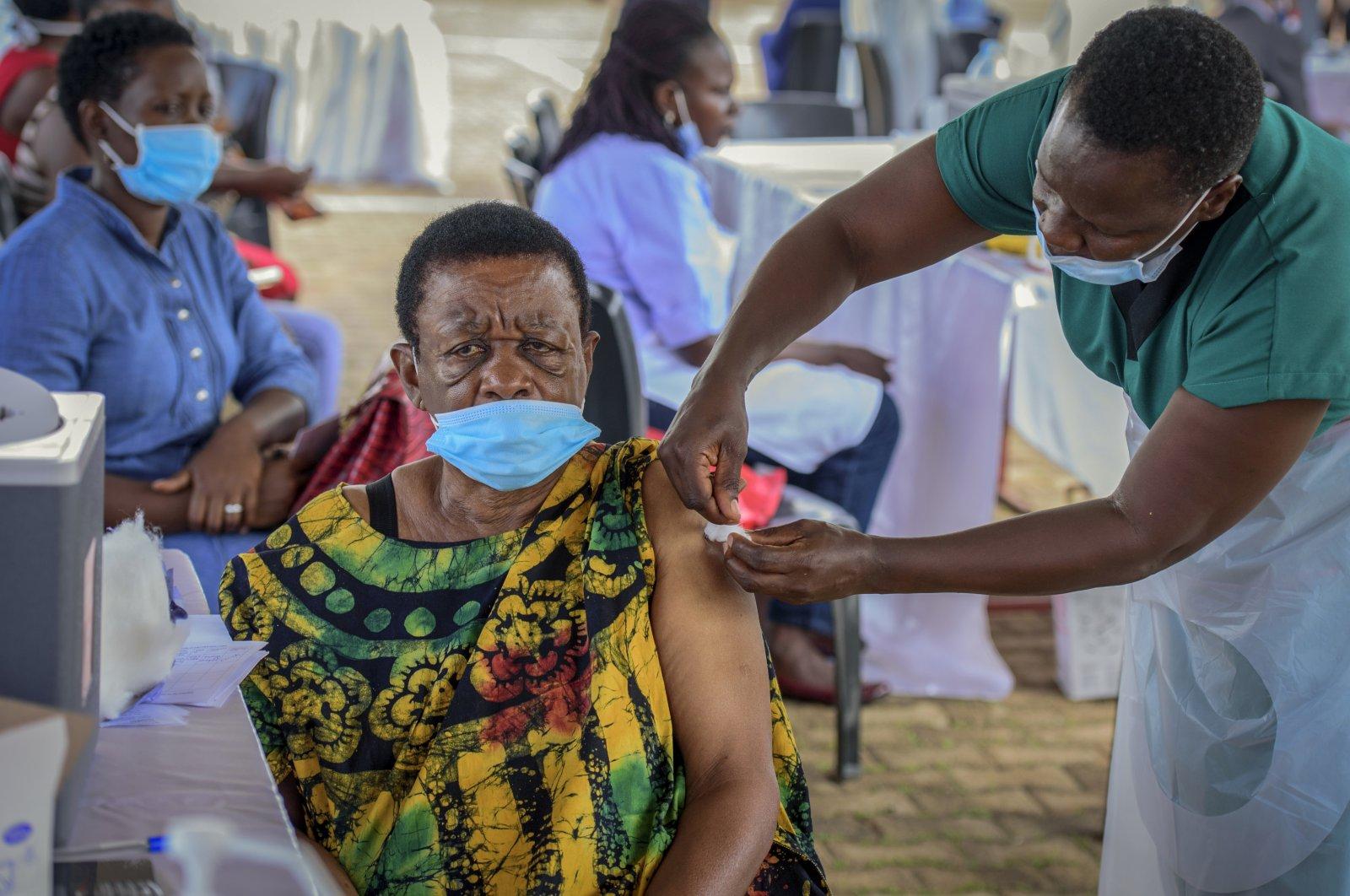 A woman receives a coronavirus vaccine shot at the Kololo airstrip in Kampala, Uganda, May 31, 2021. (AP Photo)