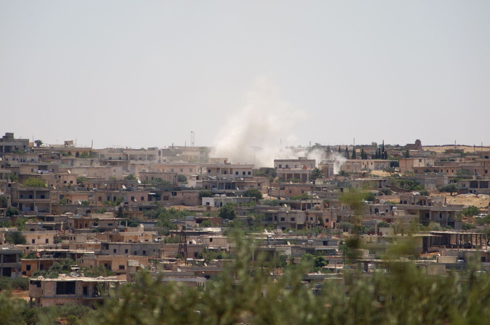 Smoke billows following a reported bombardment by regime forces in the town of Barah, Idlib province, northwestern Syria, June 21, 2021. (AFP Photo)