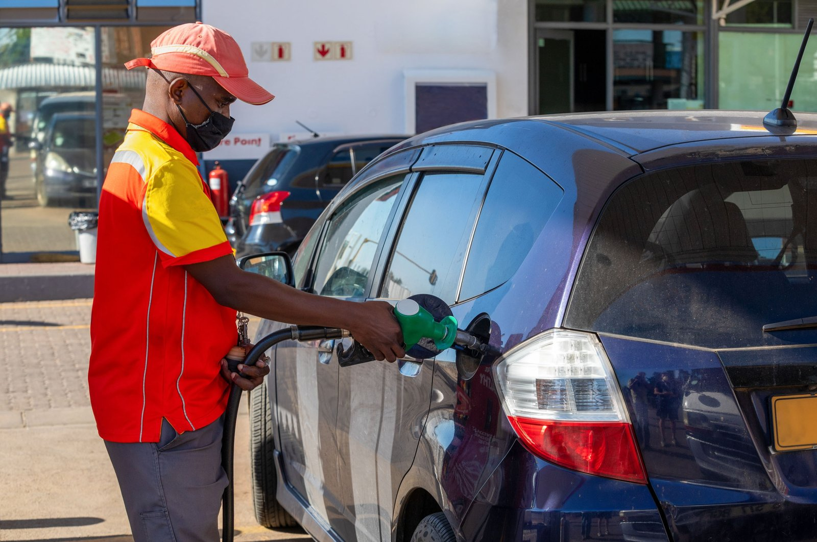African petrol attendant at a gas station in Botswana. (Shutterstock Photo)