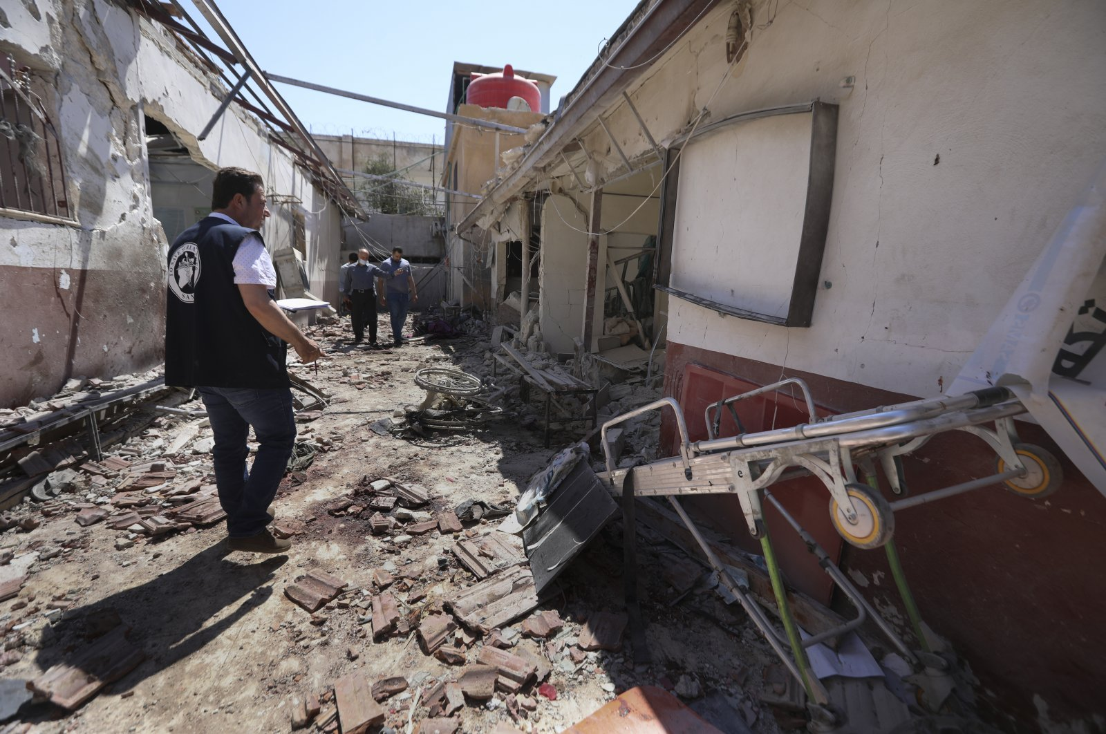 A man walks through a heavily damaged hospital hit by YPG/PKK terrorists in the city of Afrin, Syria, June 13, 2021. (AP Photo)