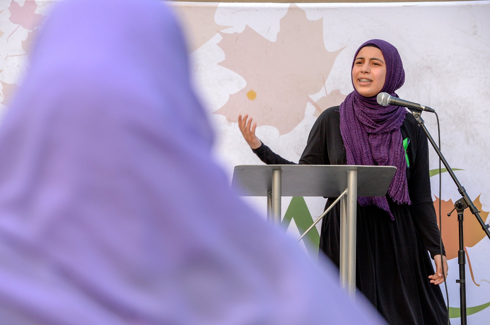 """Ayah Elmallah recites one of her poems titled """"Terror Is"""" at a rally to highlight Islamophobia, sponsored by the Muslim Association of Canada, including the June 6 in London, Ontario attack which killed a Muslim family in what police describe as a hate-motivated crime, in Toronto, Ontario, Canada, June 18, 2021. (Reuters Photo)"""