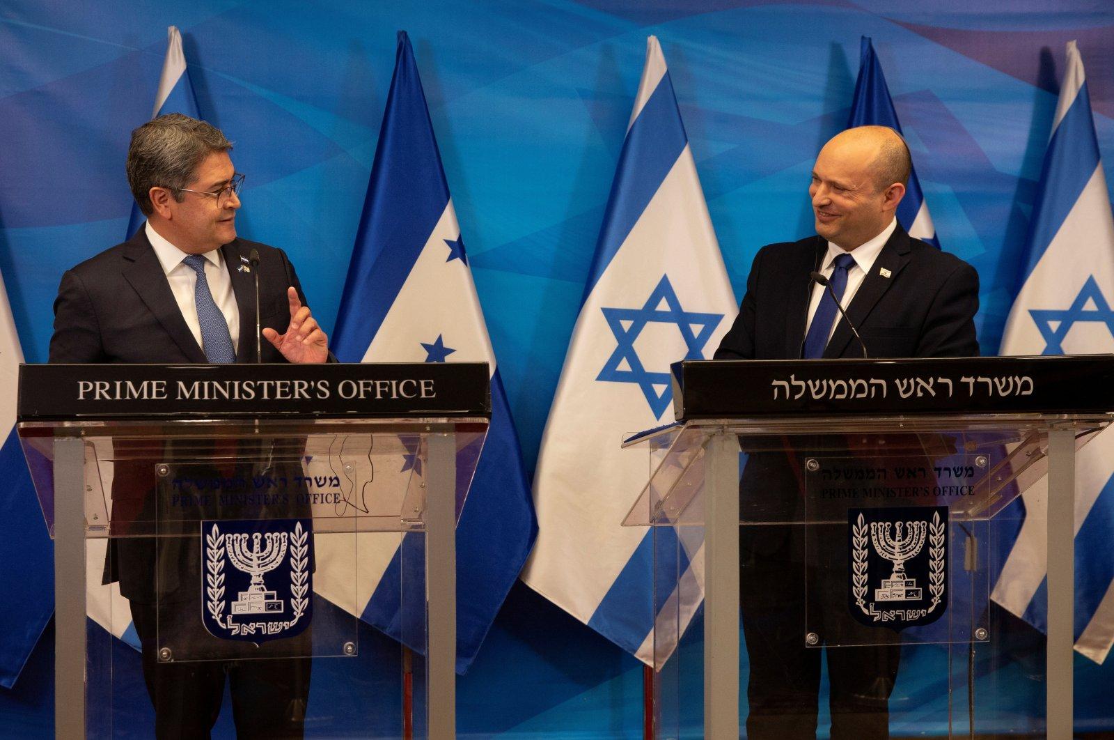Israeli Prime Minister Naftali Bennett and Honduran President Juan Orlando Hernandez attend a joint statement at the Prime Minister's Office in West Jerusalem, Israel, June 24, 2021. (Reuters Photo)