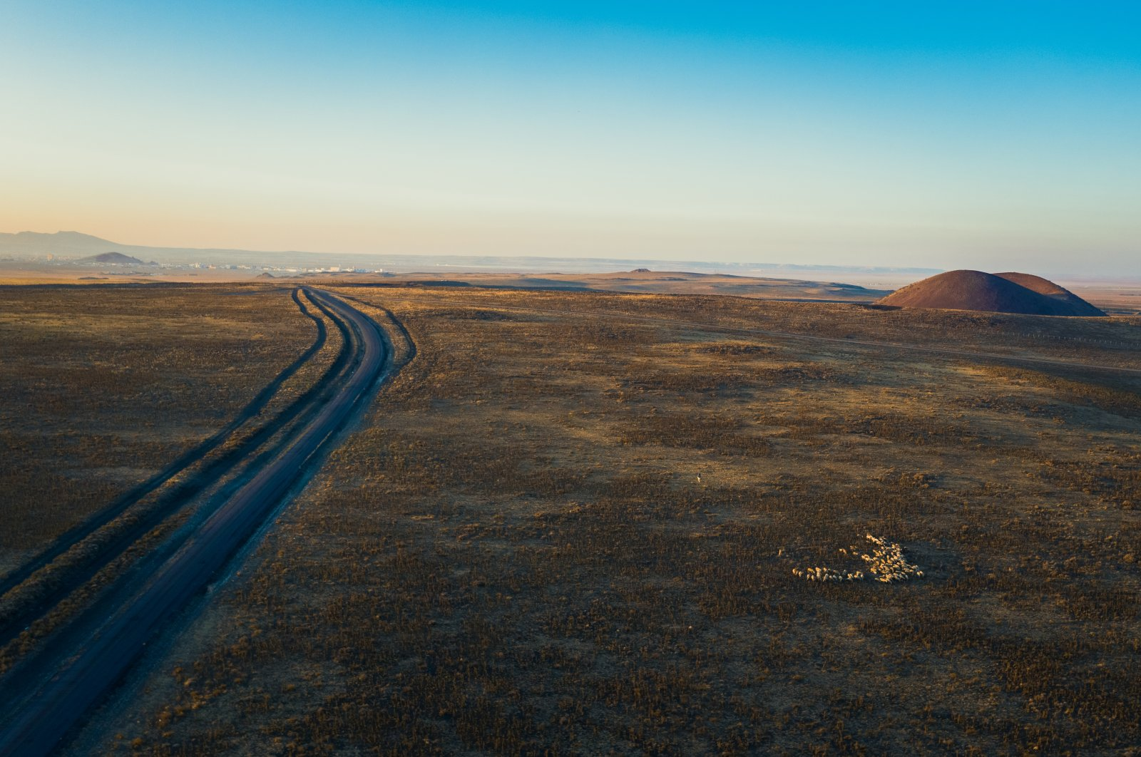 An aerial view shows a long road near Lake Meke, a volcanic crater lake in the Karapınar district of Konya, Turkey. (Shutterstock Photo)
