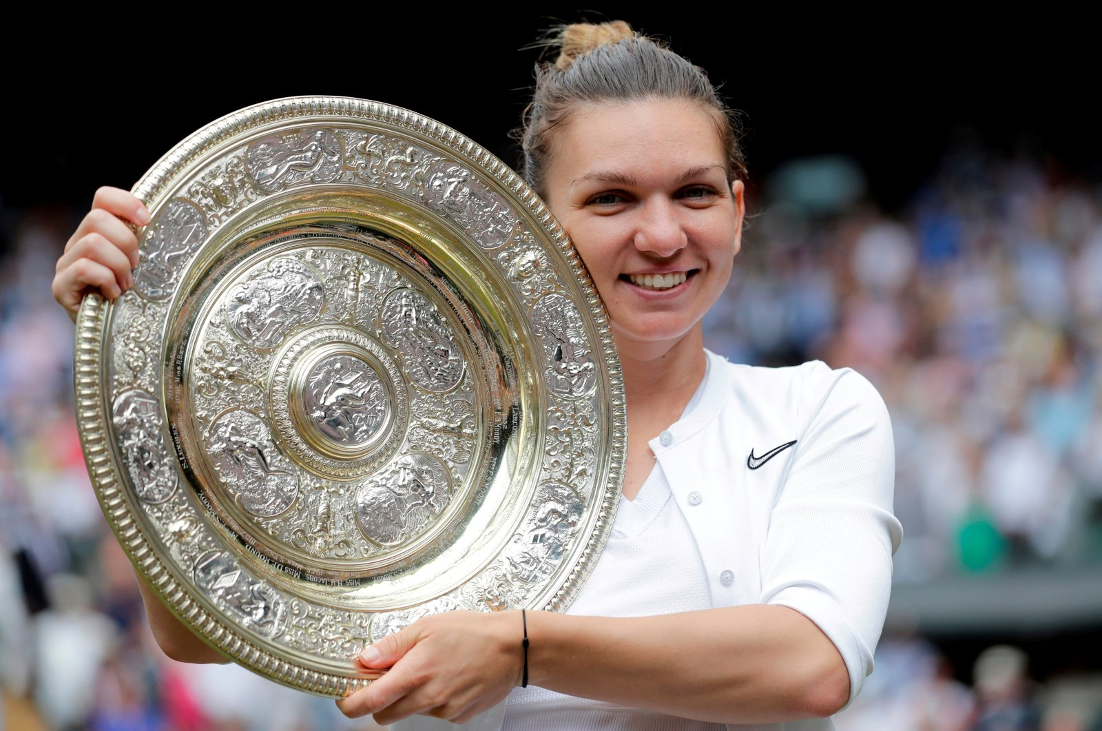 Romania's Simona Halep poses with the trophy after winning the Wimbledon women's singles final against Serena Williams, London, England, July 13, 2019. (Reuters Photo)