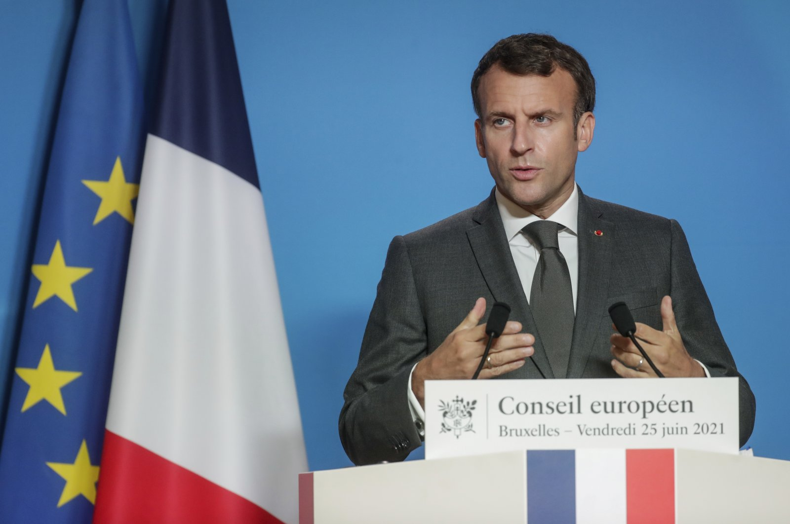 French President Emmanuel Macron talks to journalists during a news conference at the end of an EU summit at the European Council building in Brussels, Friday, June 25, 2021. (AP Photo)