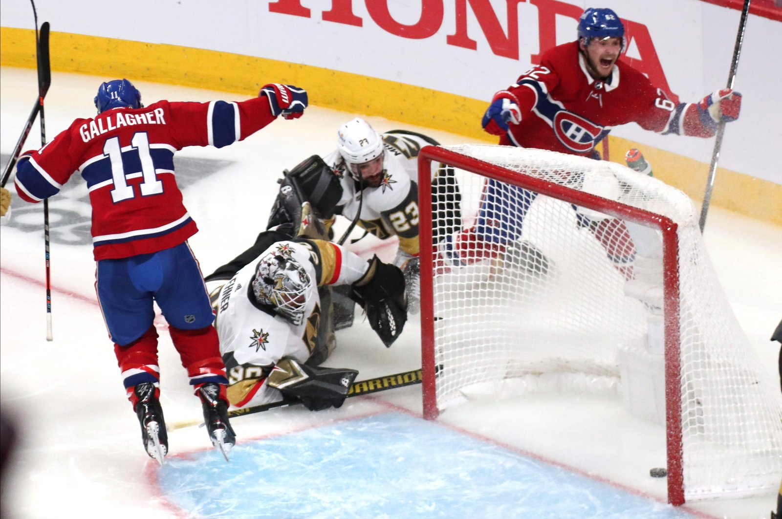Montreal Canadiens left wing Artturi Lehkonen (62) celebrates his goal against Vegas Golden Knights goaltender Robin Lehner (90) with teammate right wing Brendan Gallagher (11) during an overtime period in game six of the 2021 Stanley Cup Semifinals at Bell Centre, Montreal, Canada, June 24, 2021. (Jean-Yves Ahern-USA TODAY Sports)
