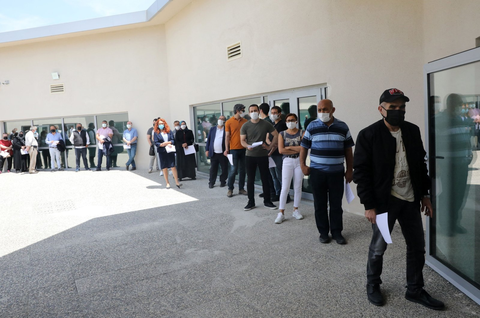 People line up to be vaccinated with Pfizer BioNTech vaccines at the Ankara City Hospital, Ankara, Turkey, June 7,  2021. ( AFP Photo)