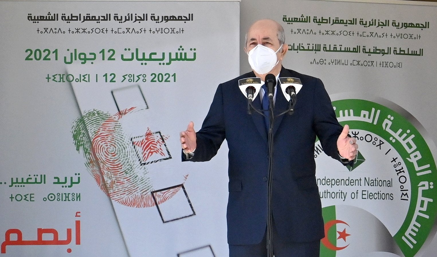 Algeria's President Abdelmadjid Tebboune speaks outside a polling station during the country's parliamentary election, Bouchaoui, Algeria, June 12, 2021. (Reuters Photo)