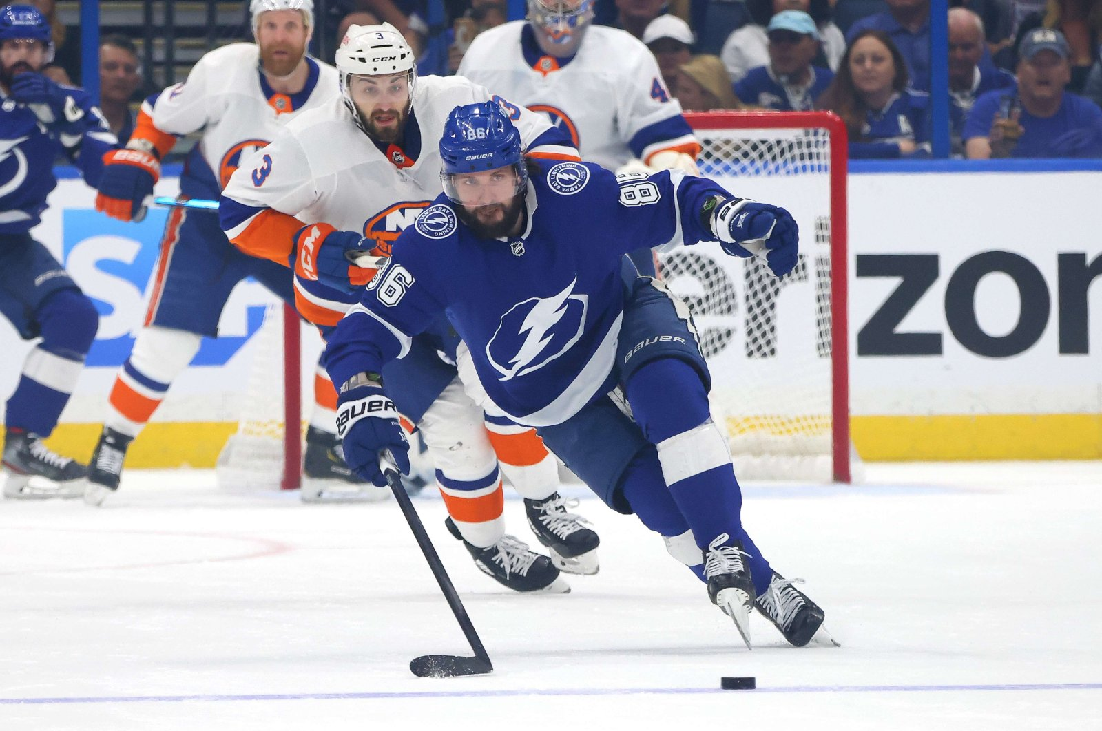 Nikita Kucherov #86 of the Tampa Bay Lightning attempts to play the puck with Adam Pelech #3 of the New York Islanders in pursuit during the first period in Game Seven of the NHL Stanley Cup Semifinals at Amalie Arena, Tampa, Florida, June 25, 2021. (AFP Photo)