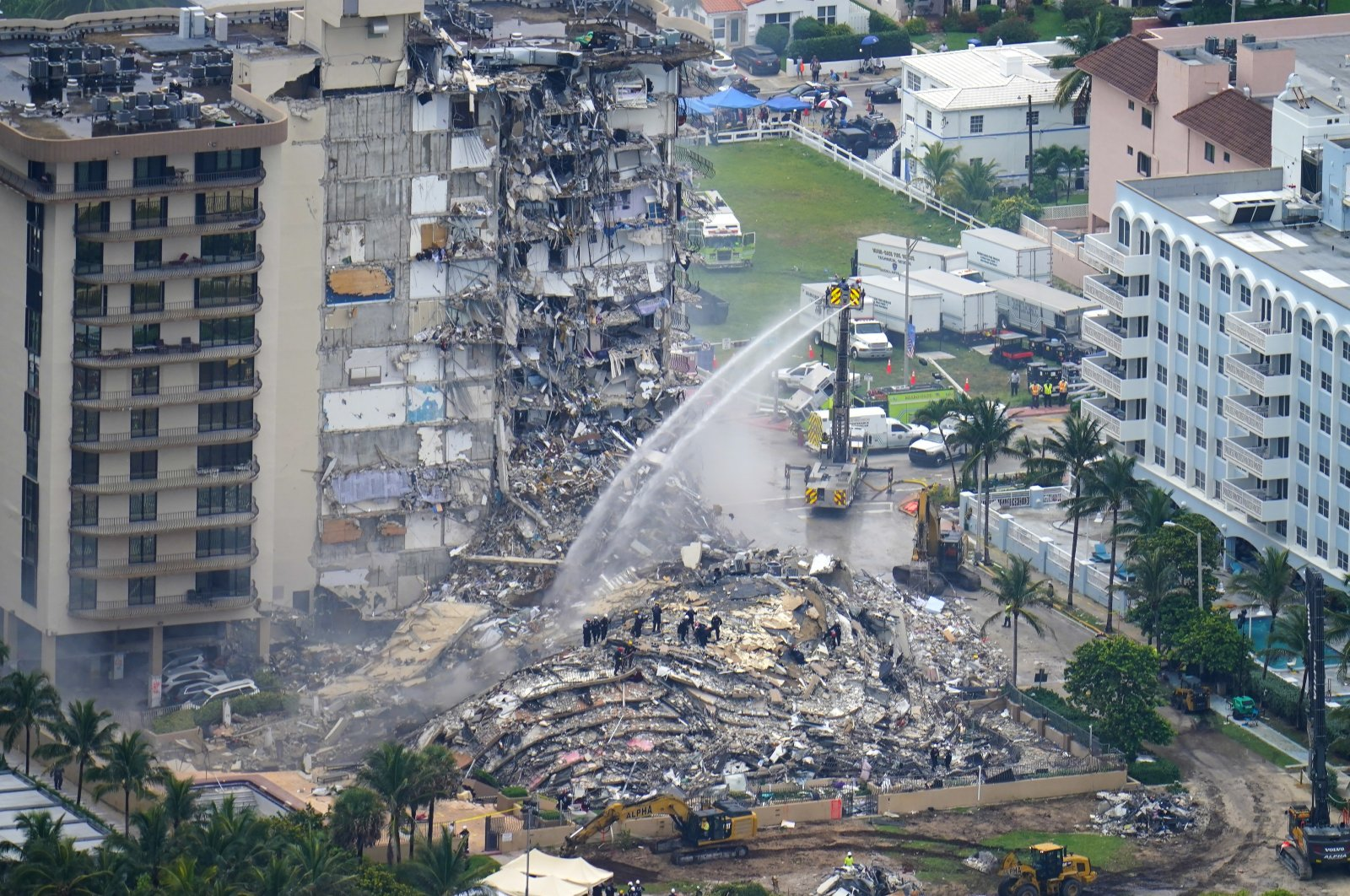 Rescue personnel work at the remains of the Champlain Towers South Condo in Surfside, Florida, U.S., June 25, 2021. (AP Photo)