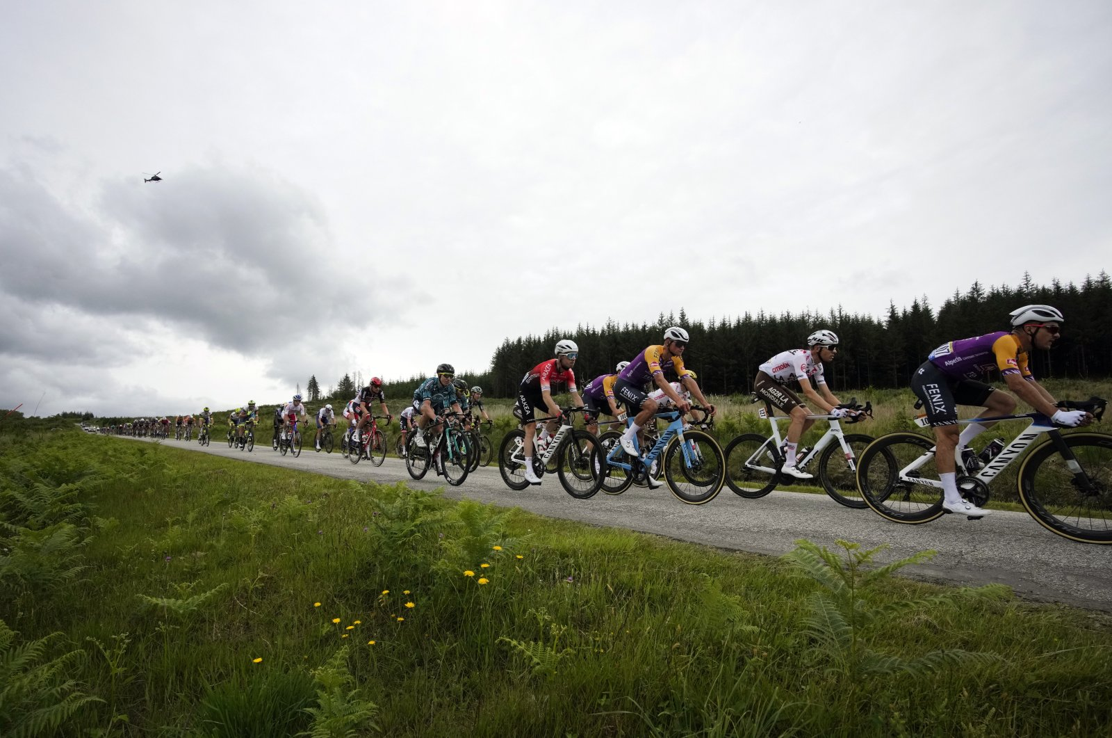 The pack rides during the first stage of the Tour de France cycling race over 197.8 kilometers (122.9 miles) with start in Brest and finish in Landerneau, France, June 26, 2021. (AP Photo)