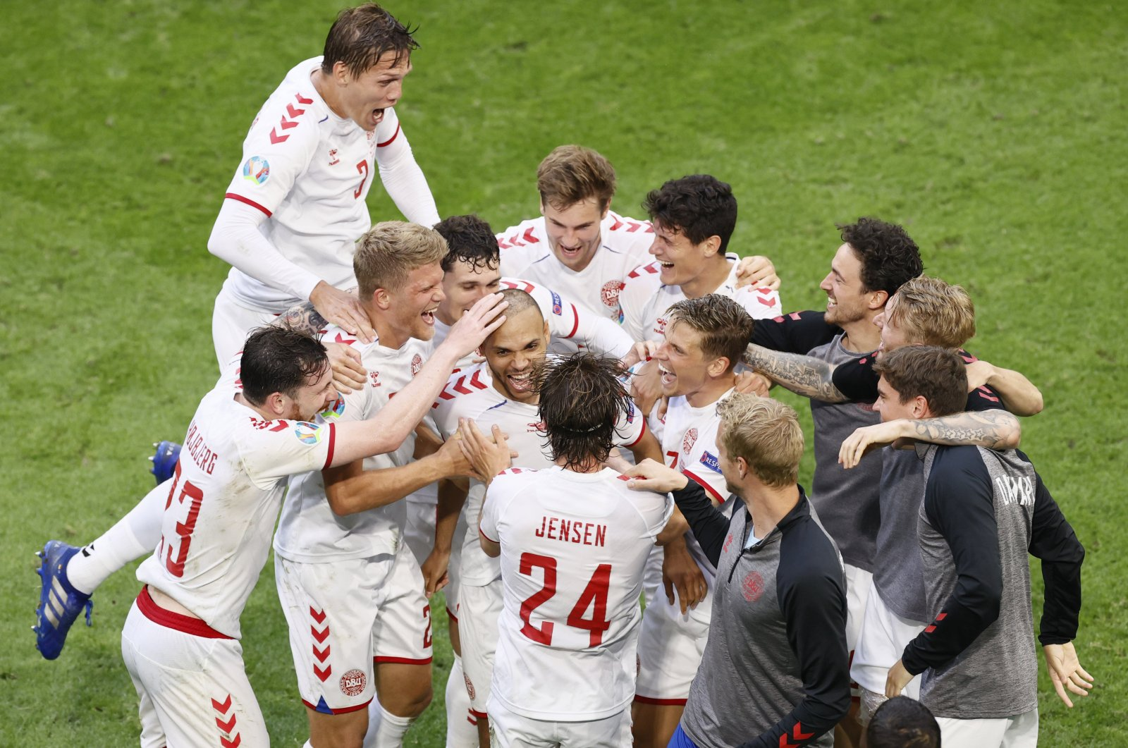 Denmark's Martin Braithwaite (C) celebrates with his teammates after his goal against Wales during the Euro 2020 match against Wales at Johan Cruyff Arena in Amsterdam, the Netherlands, June 26, 2021. (AP Photo)