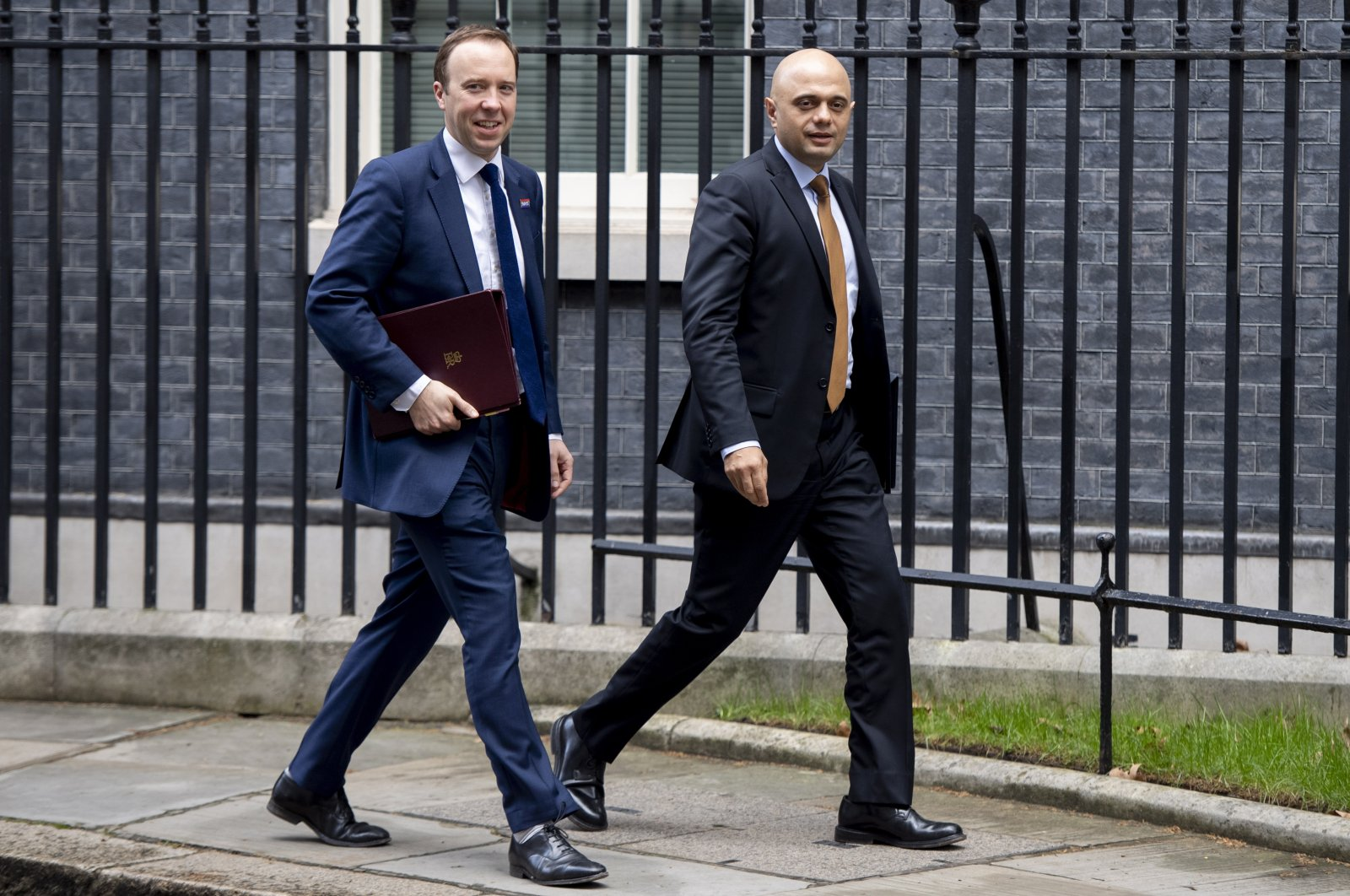 Former British Secretary of State for Health Matt Hancock (L) and then-Home Secretary Sajid Javid (R) leave after a cabinet meeting at Downing Street, London, the U.K., March 19, 2019. (EPA Photo)