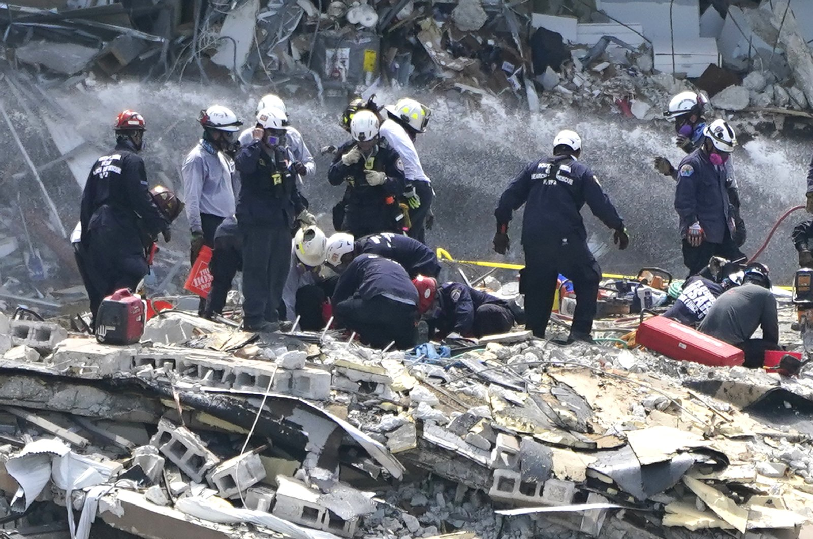 Rescue workers search the rubble of the Champlain Towers South condominium, Surfside, Florida, U.S., June 26, 2021. (AP Photo)