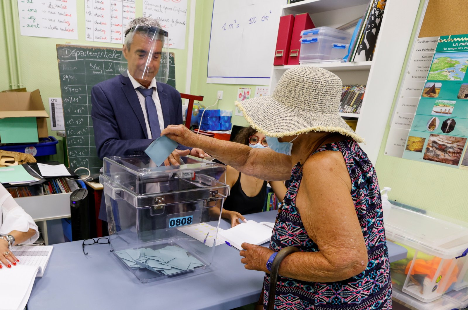A woman casts her vote at a polling station during the second round of French regional and departmental elections, in Marseille, France, June 27, 2021. (Reuters Photo)