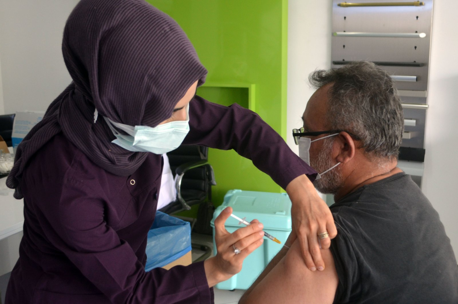 A nurse administers a COVID-19 vaccine jab to a citizen at a hospital in Turkey's northern Amasya province, the province with the second-highest vaccination rate, Amasya, Turkey, June 26, 2021. (AA Photo)