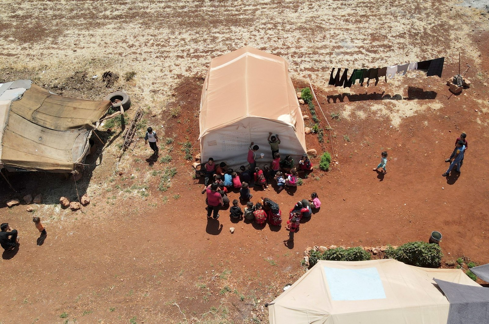 An aerial view shows children attending a class at a camp for internally displaced people in northern Idlib, Syria, June 10, 2021. (Reuters Photo)