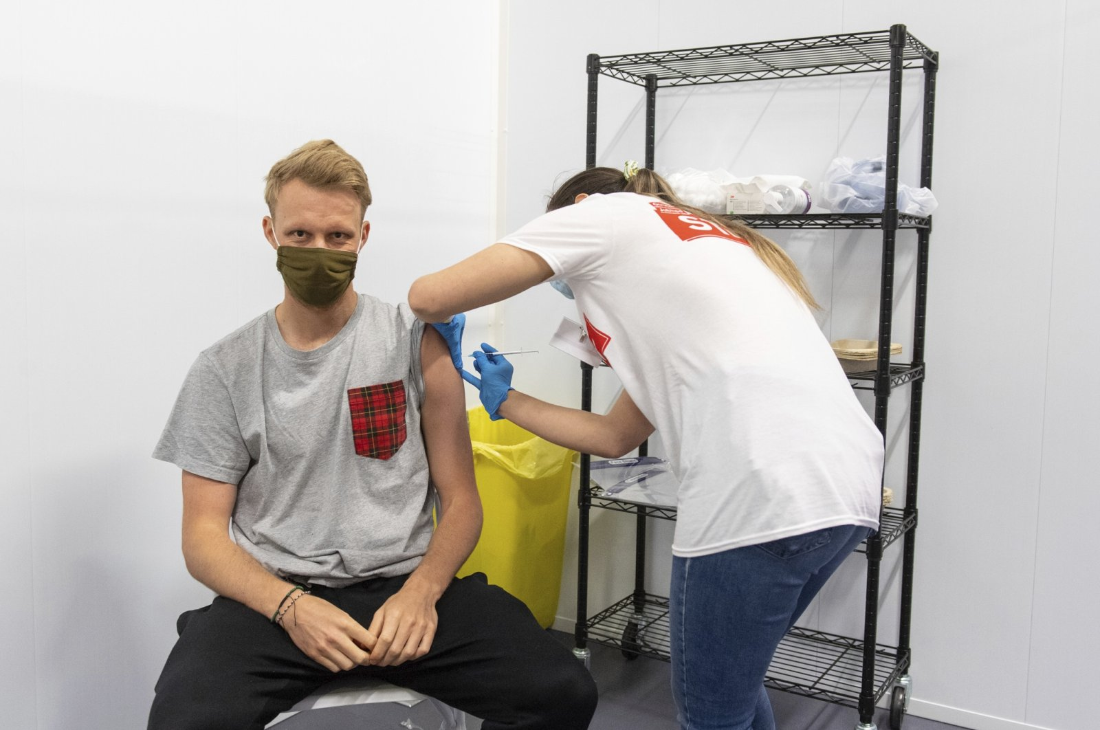 A man receives a dose of a COVID-19 vaccine at a mass coronavirus vaccination center in Arsenal's Emirates Stadium, London, U.K., June 25, 2021. (AP Photo)