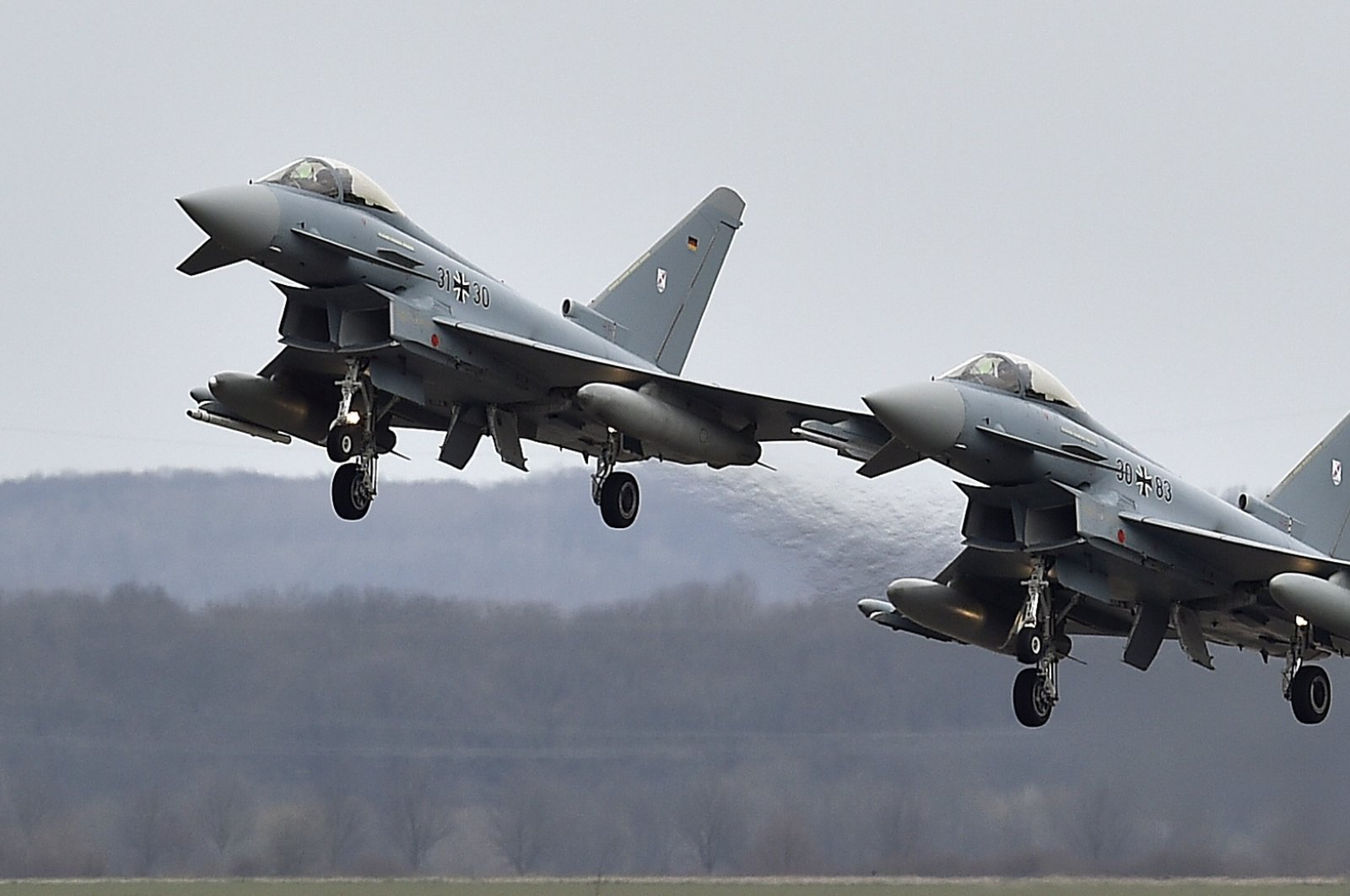Two Eurofighter jets perform a fly by at the German Air Force Base in Noervenich, Germany, March 21, 2016. (AP Photo)