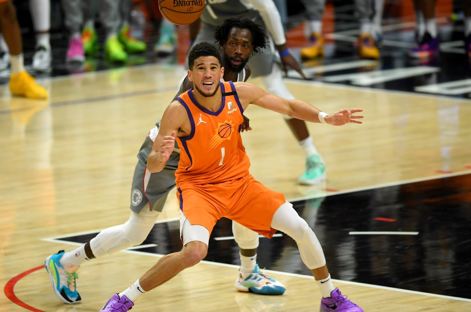 Phoenix Suns guard Devin Booker (front) is shadowed by Los Angeles Clippers guard Patrick Beverley in Game 4 of 2021 NBA Playoffs Western Conference Finals at Staples Center, Los Angeles, California, U.S., June 27, 2021.