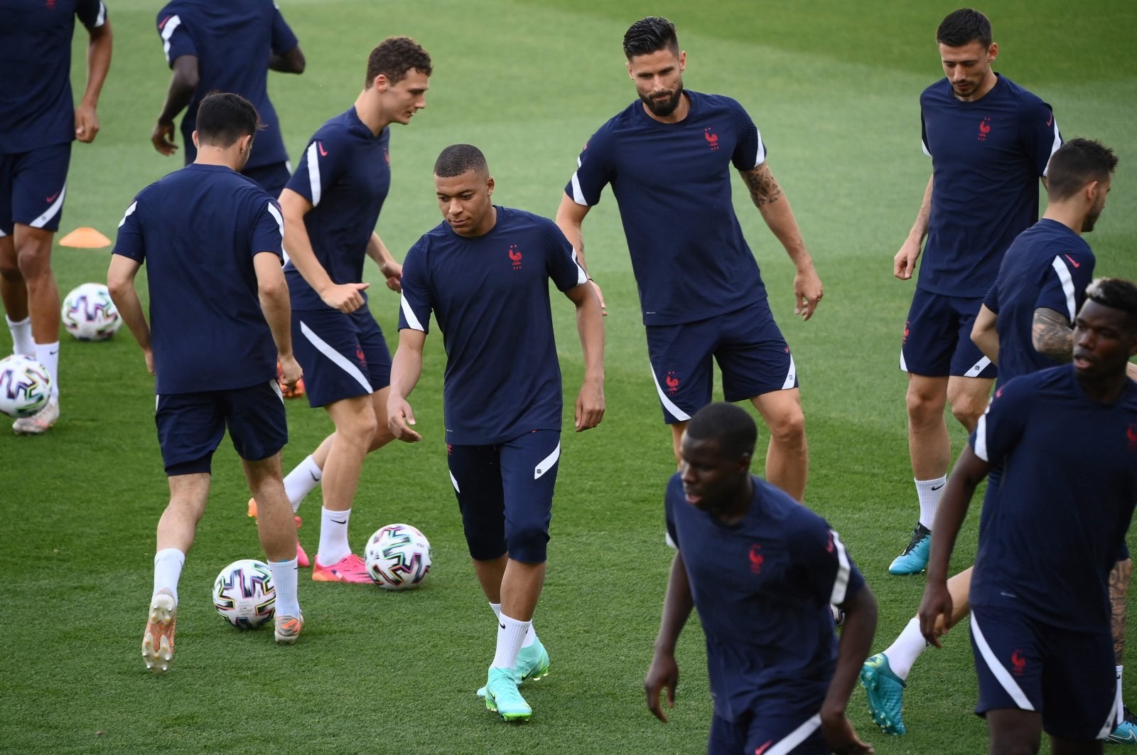 France forward Kylian Mbappe (C) and teammates take part in a training session at the Hidegkuti Stadium, Budapest, Hungary, June 22, 2021. (AFP Photo)