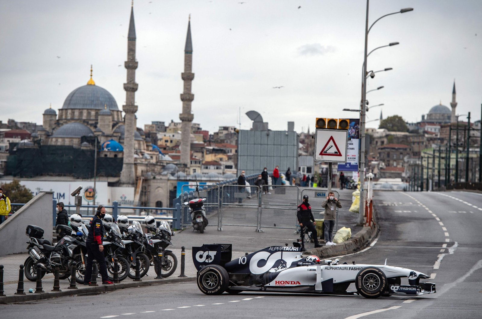 Scuderia AlphaTauri Honda French Formula One driver Pierre Gasly drives his car across the Galata Bridge while shooting a Formula One promotional movie in Istanbul, Turkey, Nov. 10, 2020. (AFP Photo)