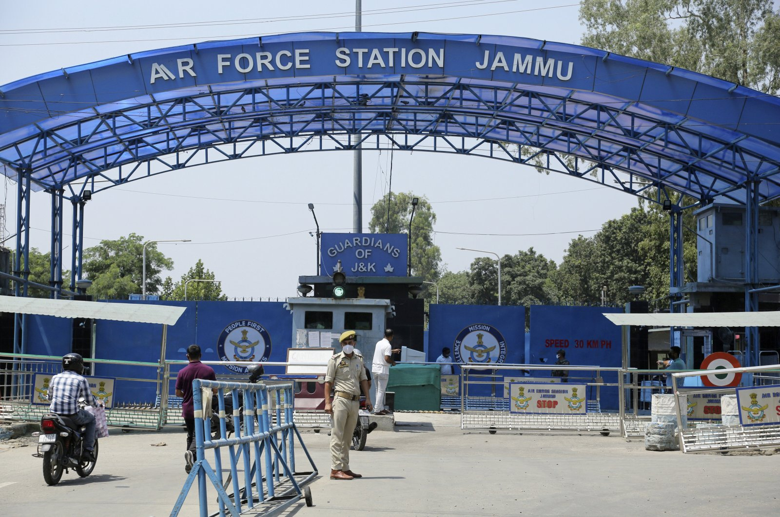 A police officer stands outside the Jammu air force station after two suspected blasts were reported early morning in Jammu, India, June 27, 2021. (AP Photo)