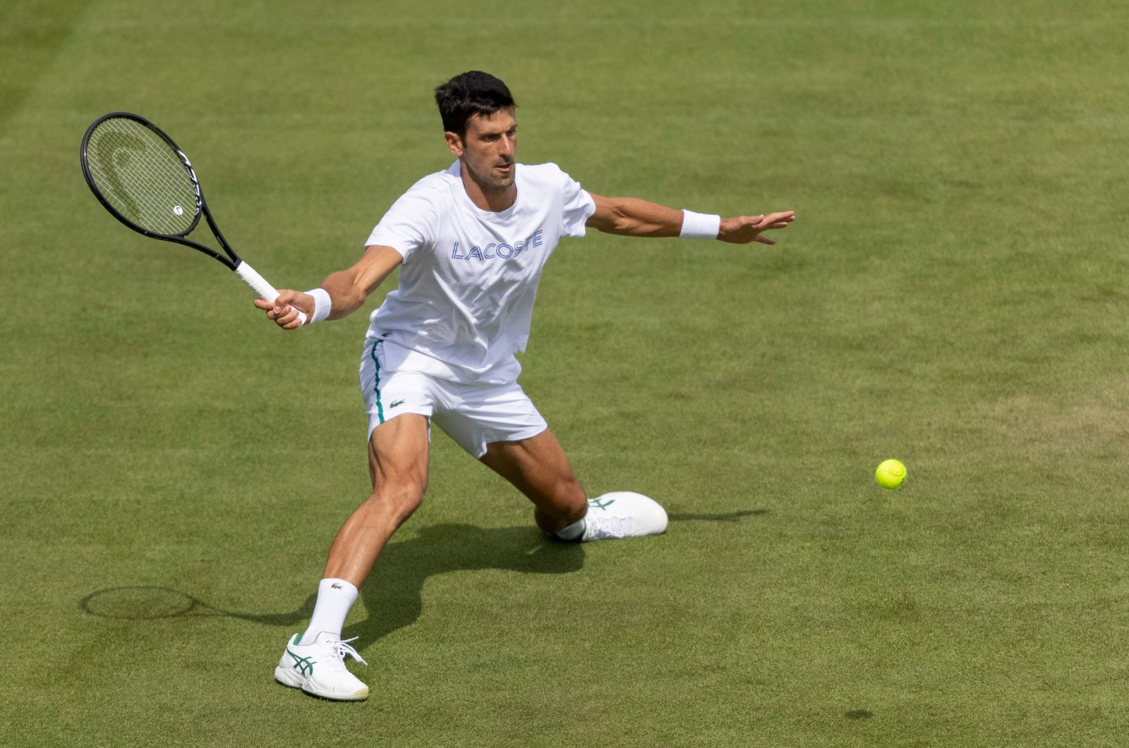 Serbia's Novak Djokovic takes part in a practice session at The All England Tennis Club in Wimbledon, southwest London, England, June 25, 2021 (AFP Photo)