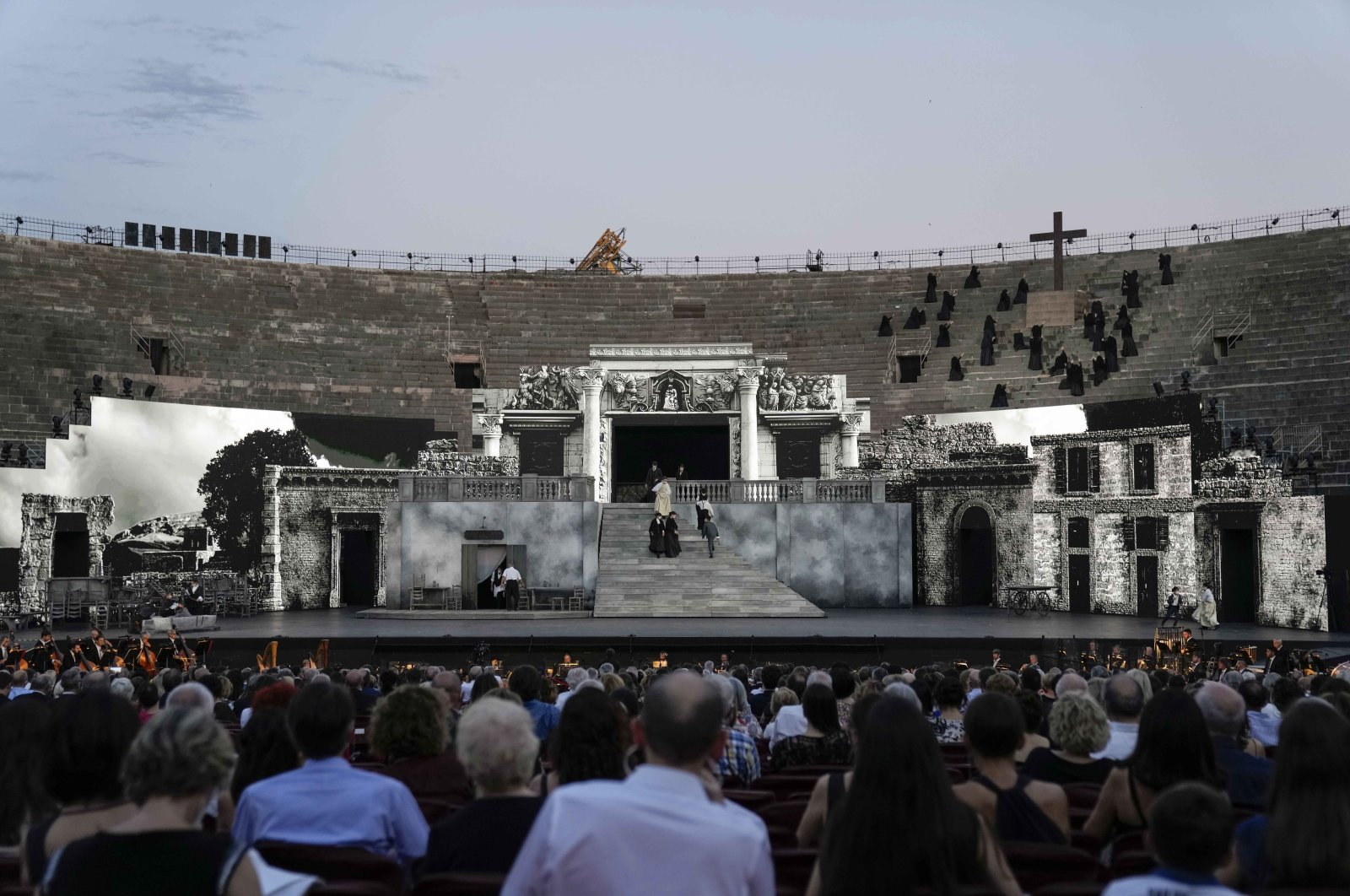 """A view of the stage during '""""Cavalleria Rusticana"""" lyric opera, at the Arena di Verona theatre, in Verona, Italy, June 25, 2021. (AP Photo)"""