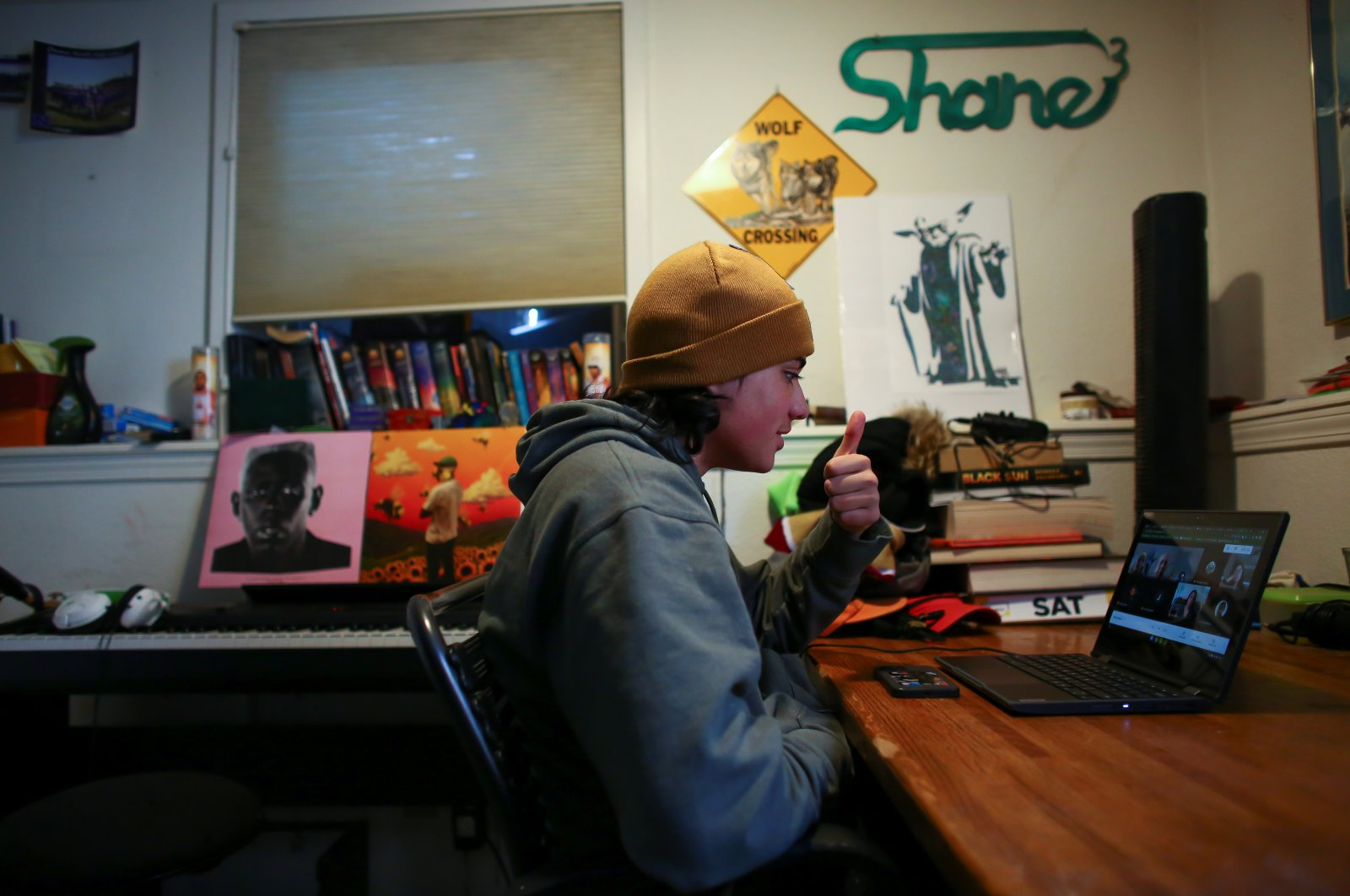 High school senior, Shane Wolf, 18, attends an online class in which Native American students meet regularly with a Lakota elder, Sid Whiting, in Denver, Colorado, U.S., March 19, 2021. (Reuters File Photo)
