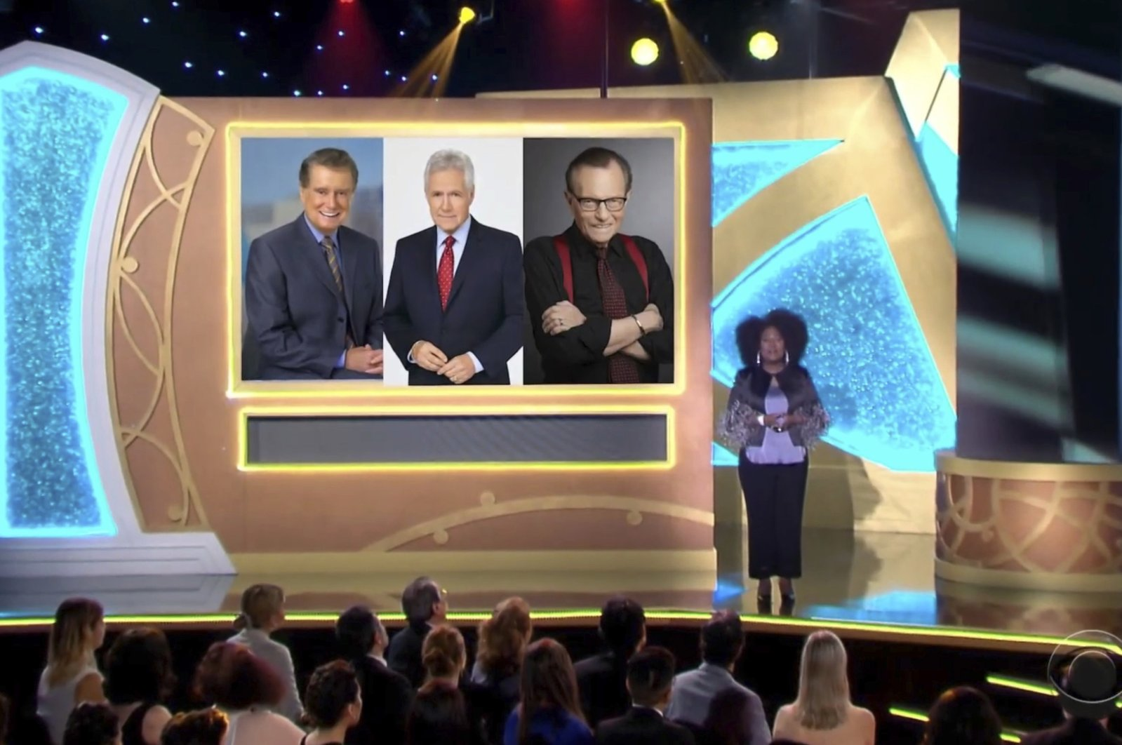 Host Sheryl Underwood introduces a tribute to the late talk show hosts, pictured on screen from Regis Philbin (L), Alex Trebek (C) and Larry King during the 48th Daytime Emmy Awards, June 25, 2021. (Daytime Emmys via AP)