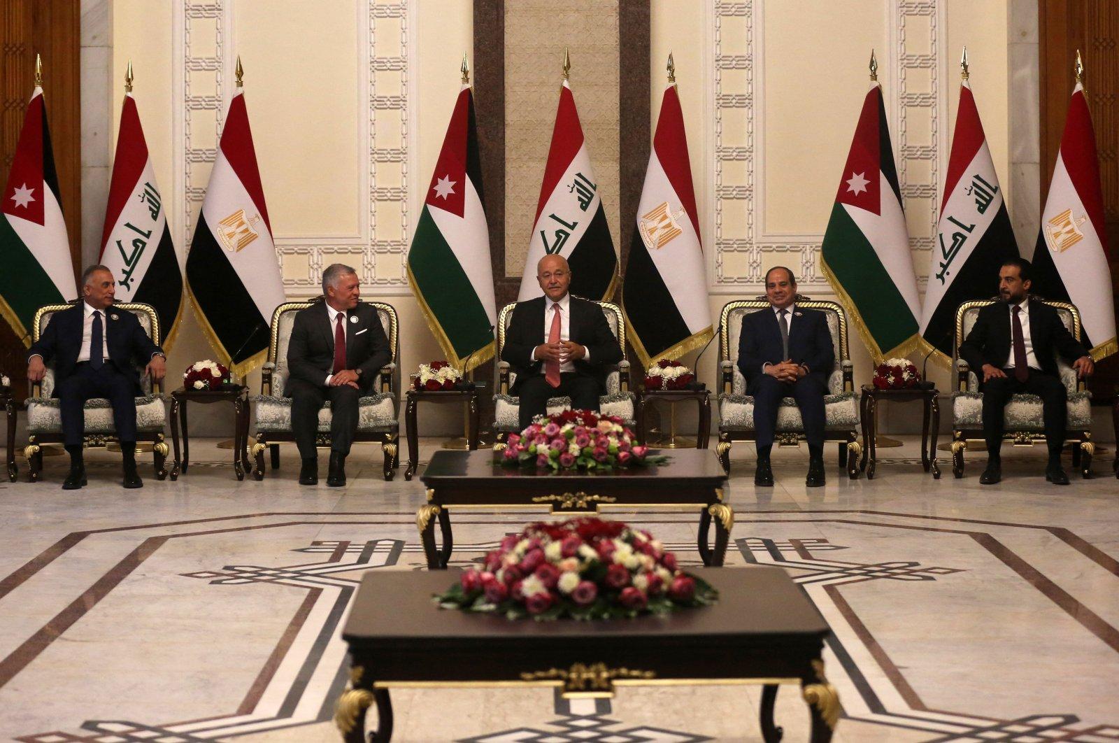 Iraqi President Barham Saleh (C), Prime Minister Mustafa Al-Kadhimi (L) and Parliament Speaker Muhammad Al-Halbousi (R) receive Egypt's President Abdel Fattah el-Sissi (C-R), and Jordan's King Abdullah II (C-L), in the capital Baghdad, Iraq, June 27, 2021. (AFP Photo)