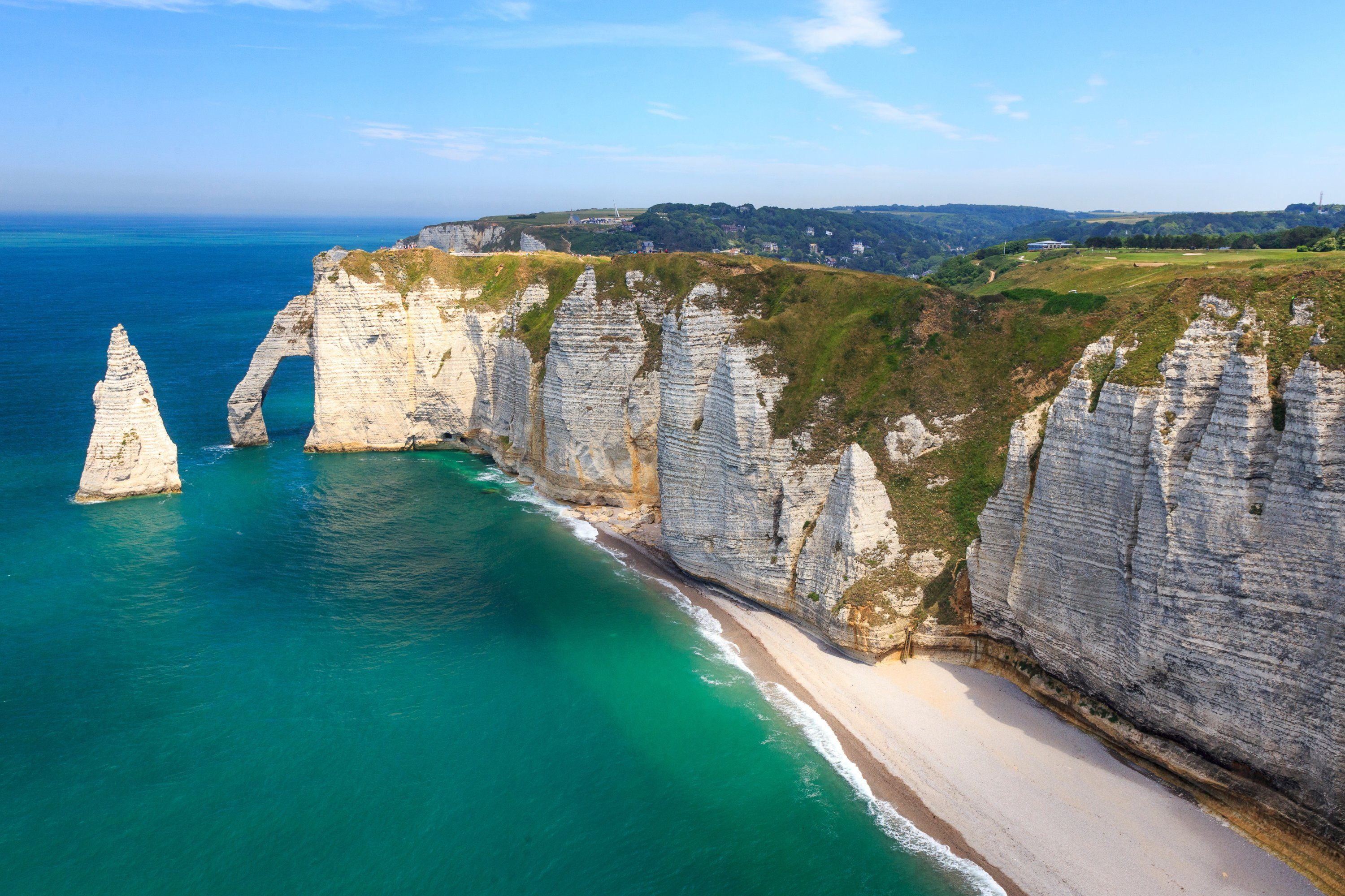 Etretat is a town on the north coast of France, known for the striking rock formations carved out of its white cliffs. (Shutterstock Photo)