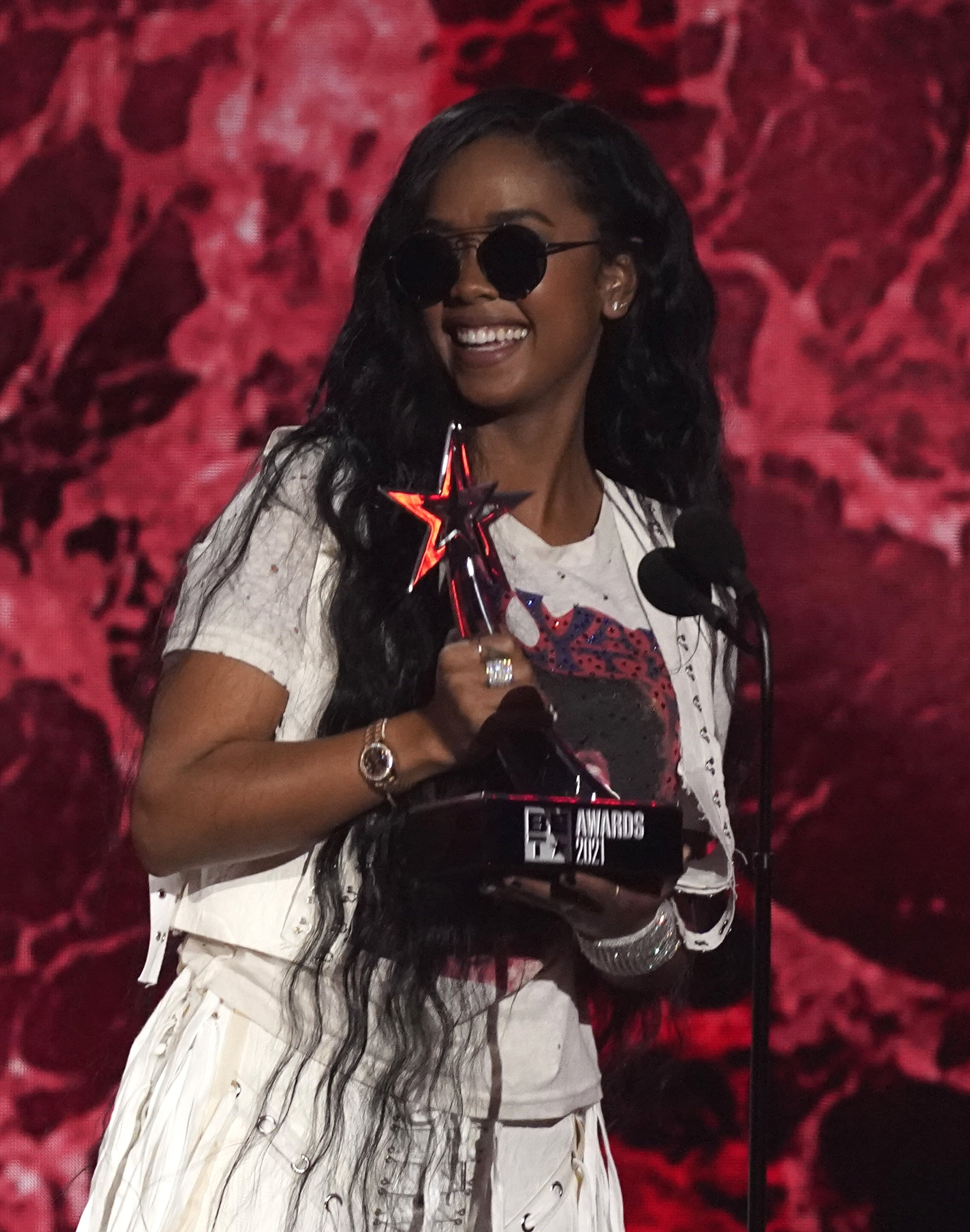 H.E.R. accepts the best female R&B pop artist award at the BET Awards at the Microsoft Theater in Los Angeles, U.S., June 27, 2021. (AP Photo)