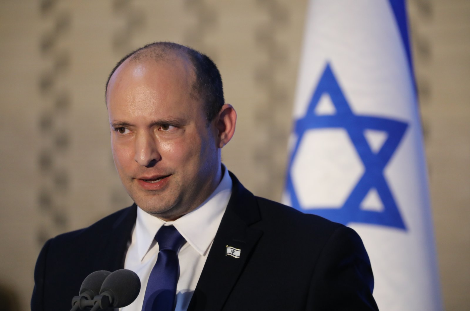 """Israeli Prime Minister Naftali Bennett speaks during a memorial ceremony for Israeli soldiers who fell in battle in the 2014 Gaza War during """"Operation Protective Edge,"""" at the Hall of Remembrance of Mount Herzl Military Cemetery in West Jerusalem, Israel, June 20, 2021. (EPA Photo)"""