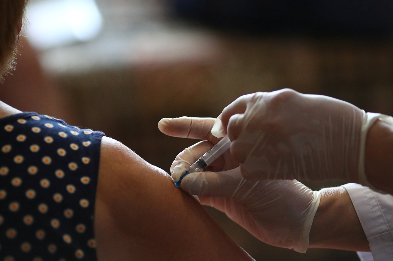 Local resident Nadezhda Dudkina receives a dose of a vaccine against the coronavirus at her home in the village of Loznoye in Volgograd region, Russia June 27, 2021. (Reuters Photo)