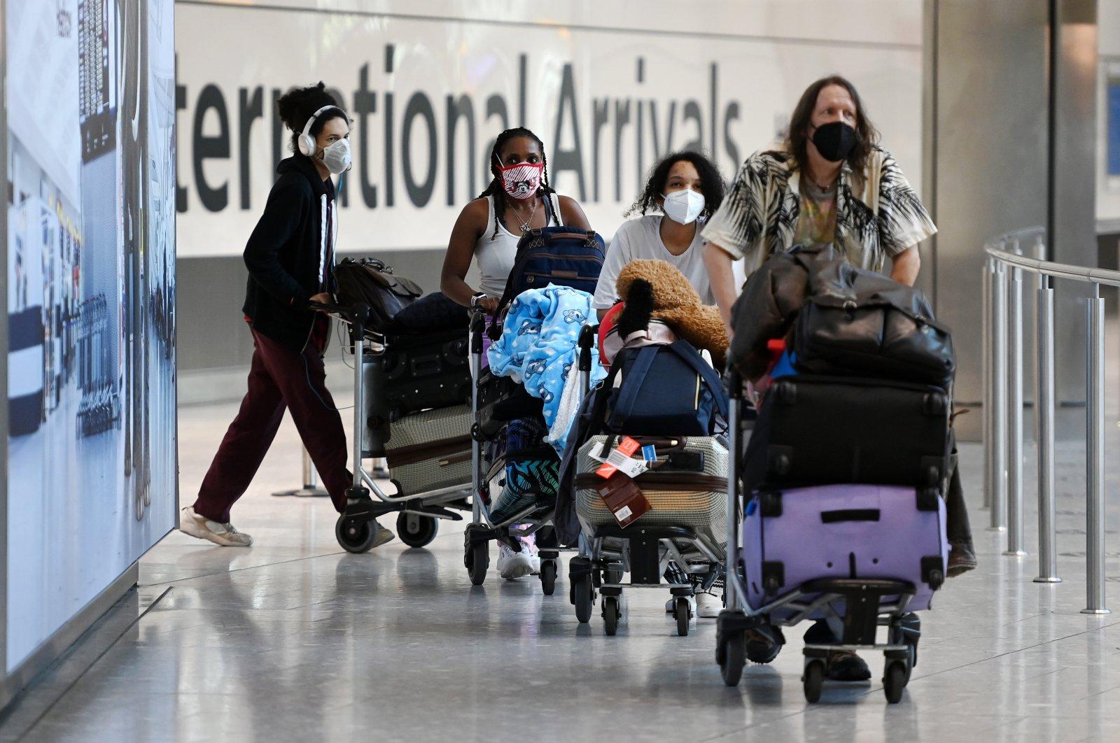 Travelers walk in Heathrow Airport in London, Britain, June 8, 2021. (EPA Photo)