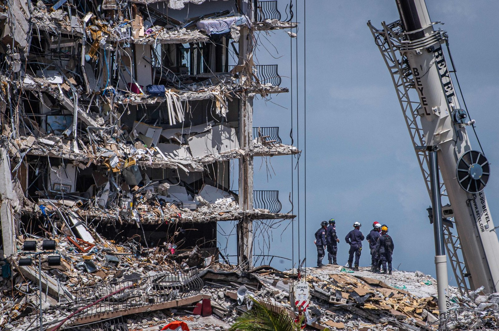 Members of the South Florida Urban Search and Rescue team look for possible survivors in the partially collapsed 12-story Champlain Towers South condo building in Surfside, Florida, U.S., June 27, 2021. (AFP Photo)