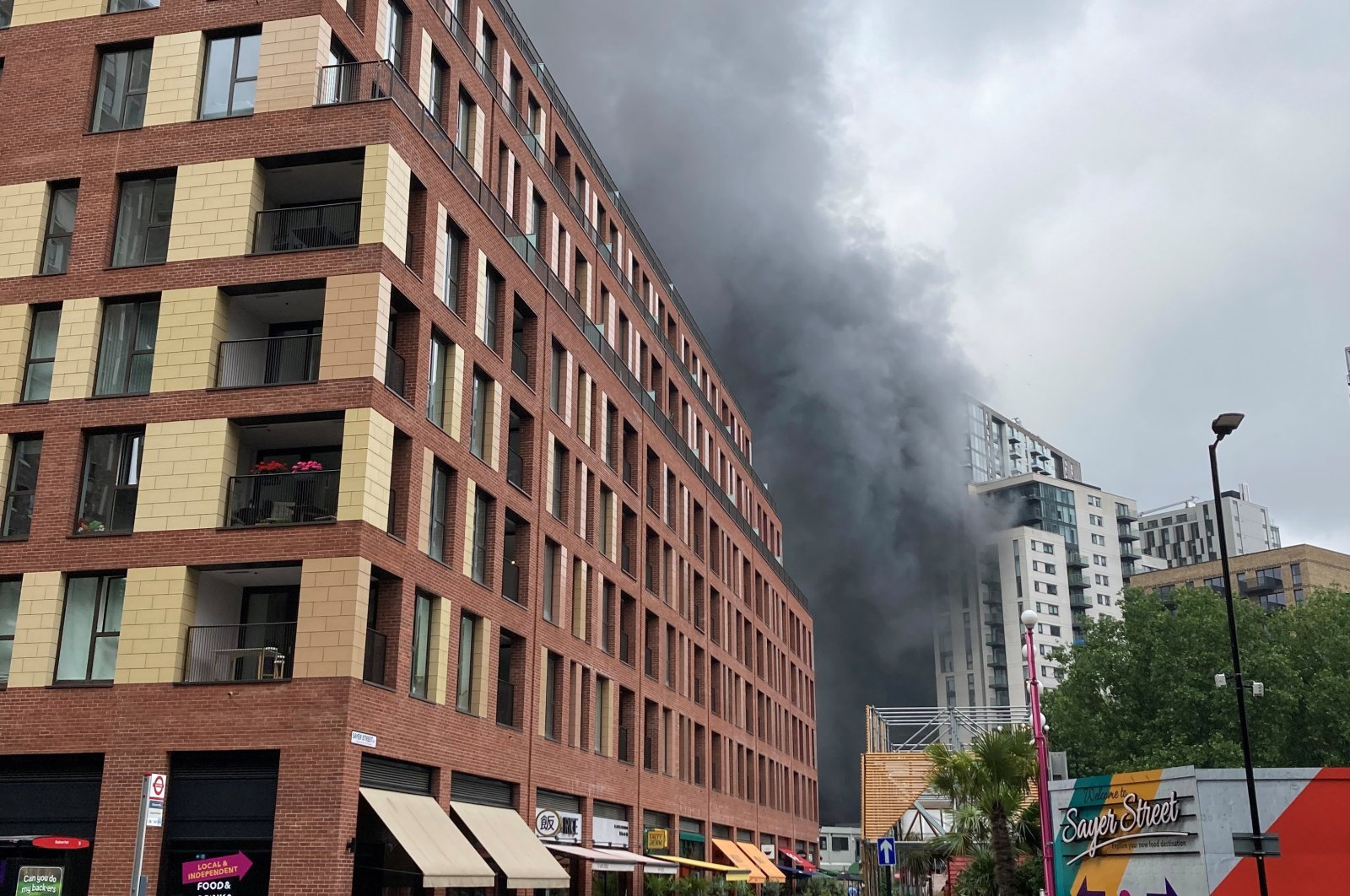 Smoke rises from the fire near Elephant and Castle station in London, Britain June 28, 2021 in this picture obtained from social media. (Social media/via Reuters)