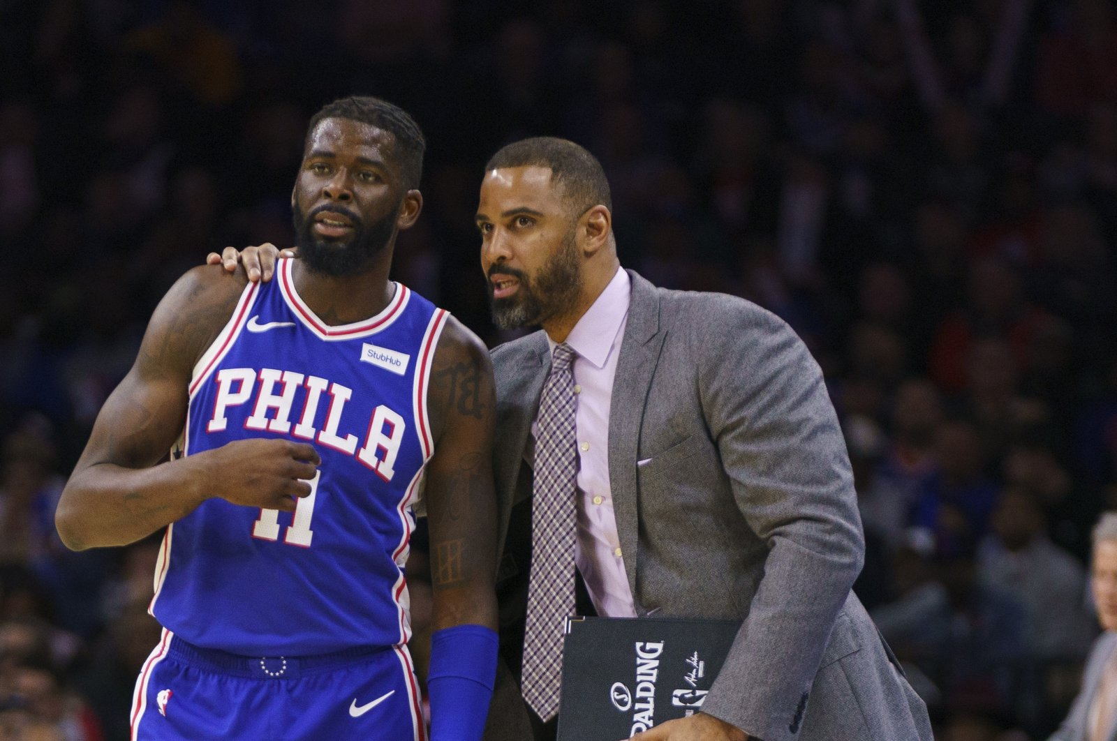 This file photo shows Philadelphia 76ers' James Ennis III (L) talking things over with assistant coach Ime Udoka (R) during the second half of an NBA basketball game against the New York Knicks, in Philadelphia, U.S., Nov. 20, 2019. (AP Photo)