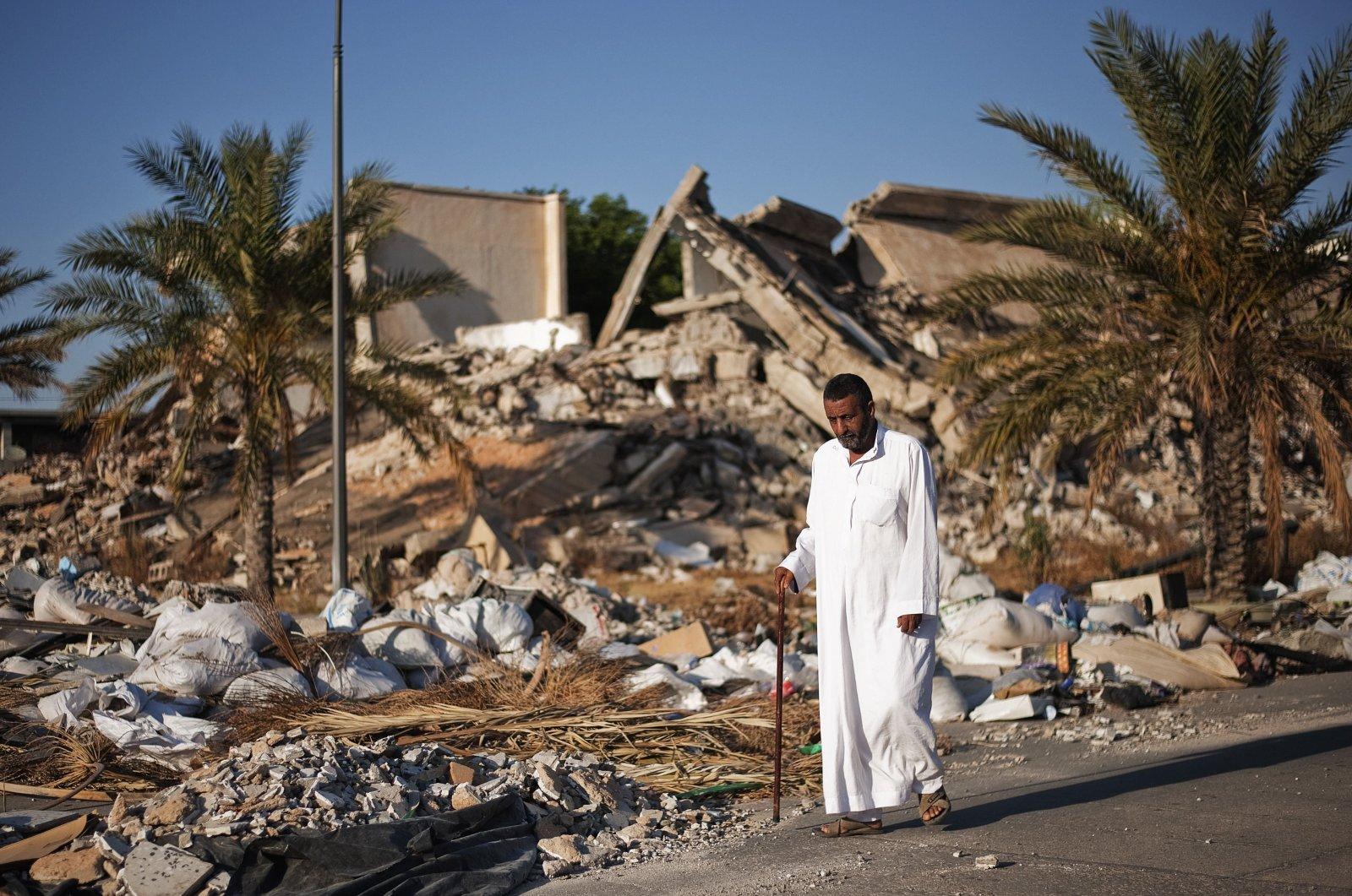 A man walks through the rubble of the destroyed compound of former Libyan leader Moammar Gadhafi, in Tripoli's Bab al-Aziziya area, Libya, June 2, 2012. (AFP File Photo)