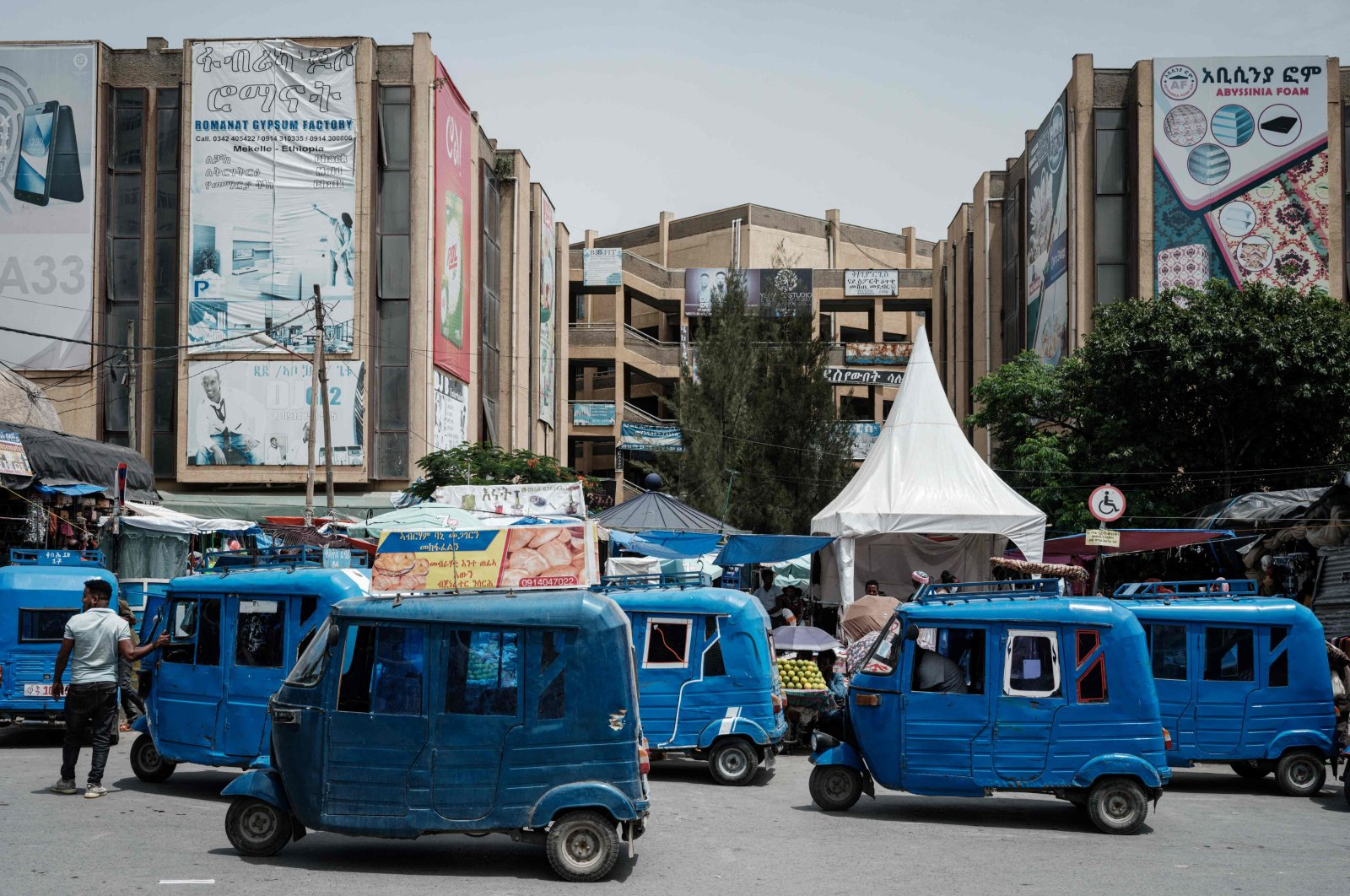 Motor tricycles wait for customers next to the downtown market in Mekele, the capital of Tigray region, Ethiopia, June 25, 2021. (AFP Photo)
