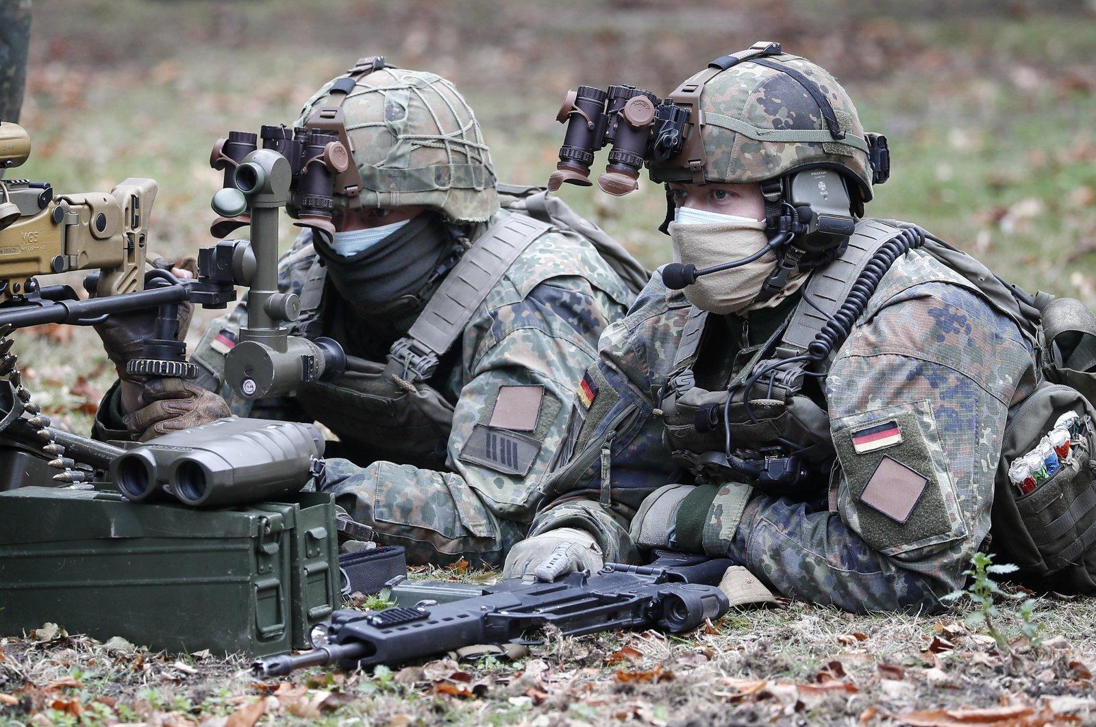 Soldiers demonstrate their skills during the visit of German President Frank-Walter Steinmeier at the German/Netherlands Corps in Muenster, Germany, Sept. 29, 2020. (AP Photo)
