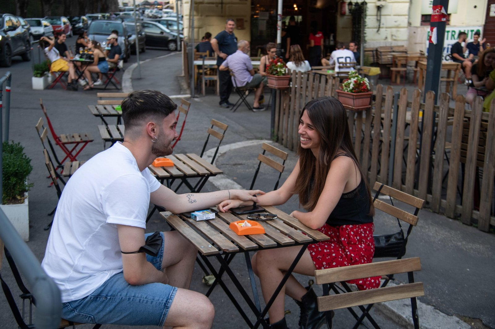 """People gather for aperitif time and dinner on the first day of Italy classed as a low-COVID-19-risk """"white zone"""" in Rome, Italy, June 28, 2021. (EPA Photo)"""